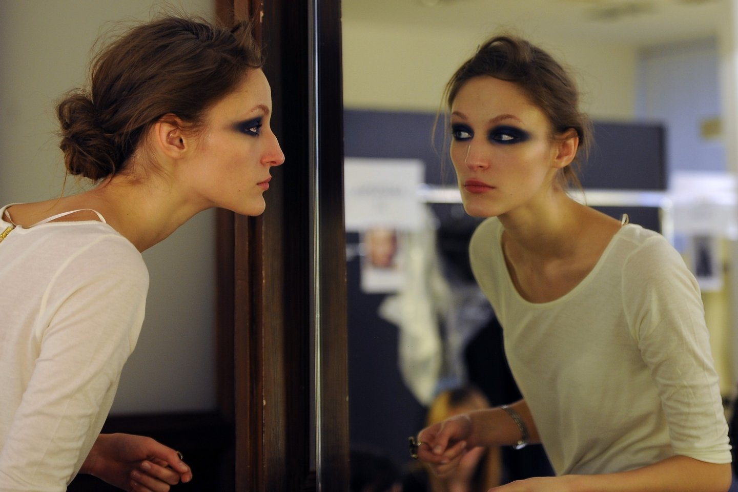 A model looks at her make-up in a mirror prior the Gianfranco Ferre Fall-winter 2012-2013 show on February 27, 2012 during the Women's fashion week in Milan.       AFP PHOTO / GABRIEL BOUYS (Photo credit should read GABRIEL BOUYS/AFP/Getty Images)