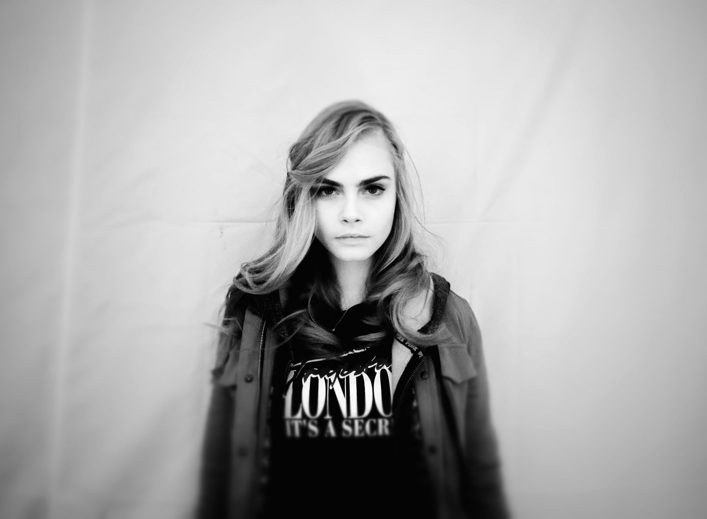 PARIS, FRANCE - FEBRUARY 27:  (Editors Note: This image was processed using digital filters) Model Cara Delevingne poses backstage before the H&M Fall/Winter 2013 Ready-to-Wear show as part of Paris Fashion Week on February 27, 2013 in Paris, France.  (Photo by Gareth Cattermole/Getty Images)