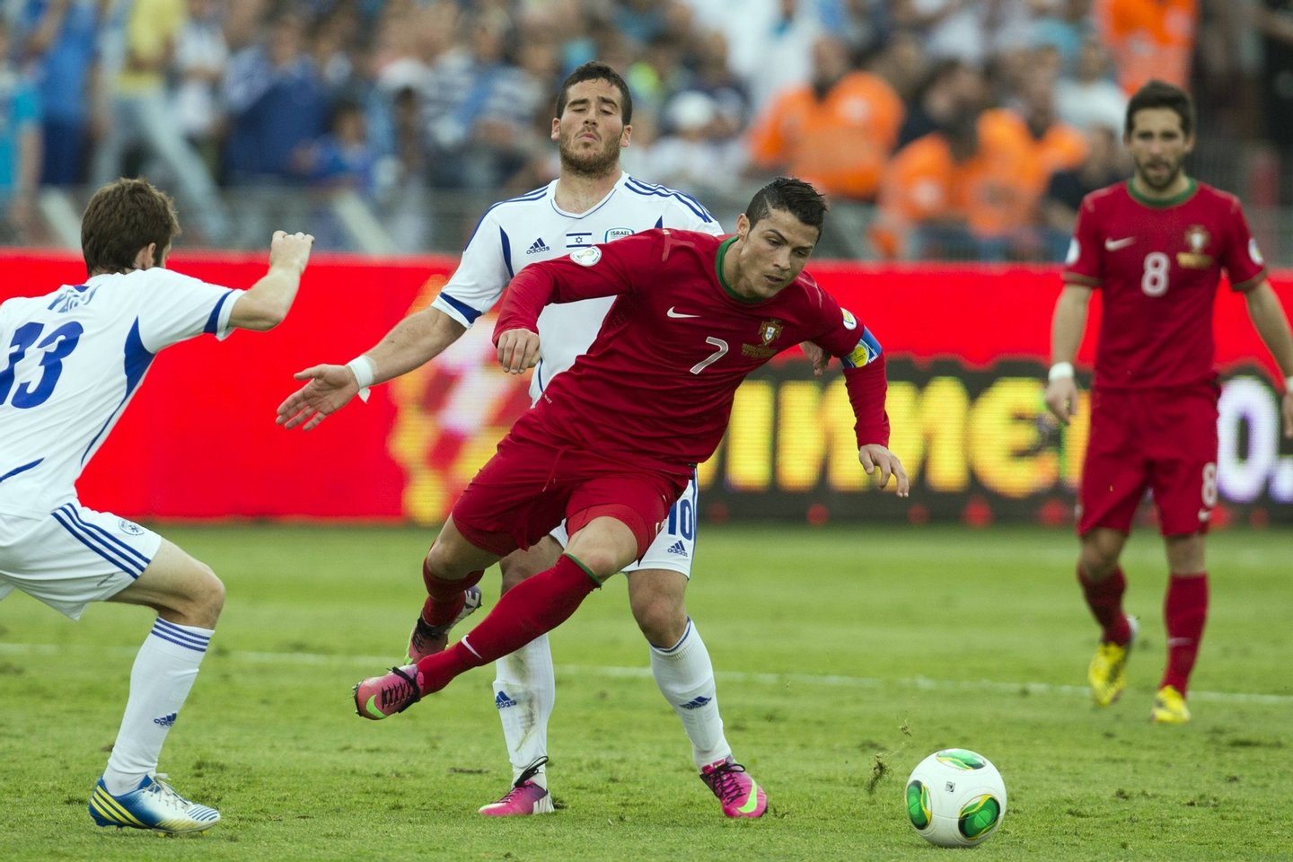 Israeli midfielder Gal alberman (back) is challenged by Portuguese forward Cristiano Ronaldo (front) during the FIFA 2014 World Cup European zone qualifying group F match between Israel and Portugal at Ramat Gan Stadium, near Tel Aviv, on March 22, 2013. AFP PHOTO / JACK GUEZ (Photo credit should read JACK GUEZ/AFP/Getty Images)