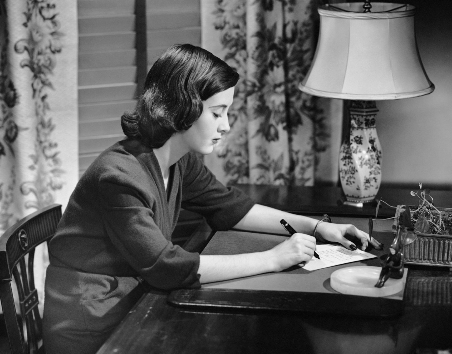 UNITED STATES - CIRCA 1950s:  Portrait of woman writing letter at desk.  (Photo by George Marks/Retrofile/Getty Images)