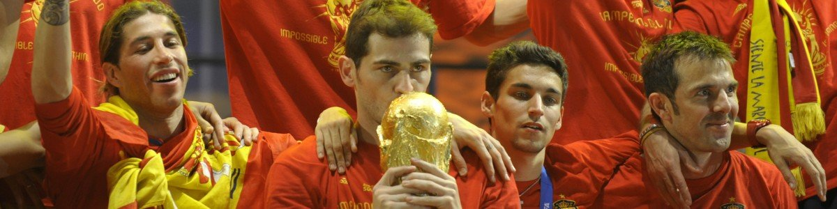 Spain's goalkeeper Iker Casillas kisses the trophy as he celebrates with team mates on a stage set up for the Spanish team victory ceremony in Madrid on July 12, 2010 a day after they won the 2010 FIFA football World Cup match against the Netherlands in Johannesburg.      AFP PHOTO / MIGUEL RIOPA (Photo credit should read MIGUEL RIOPA/AFP/Getty Images)