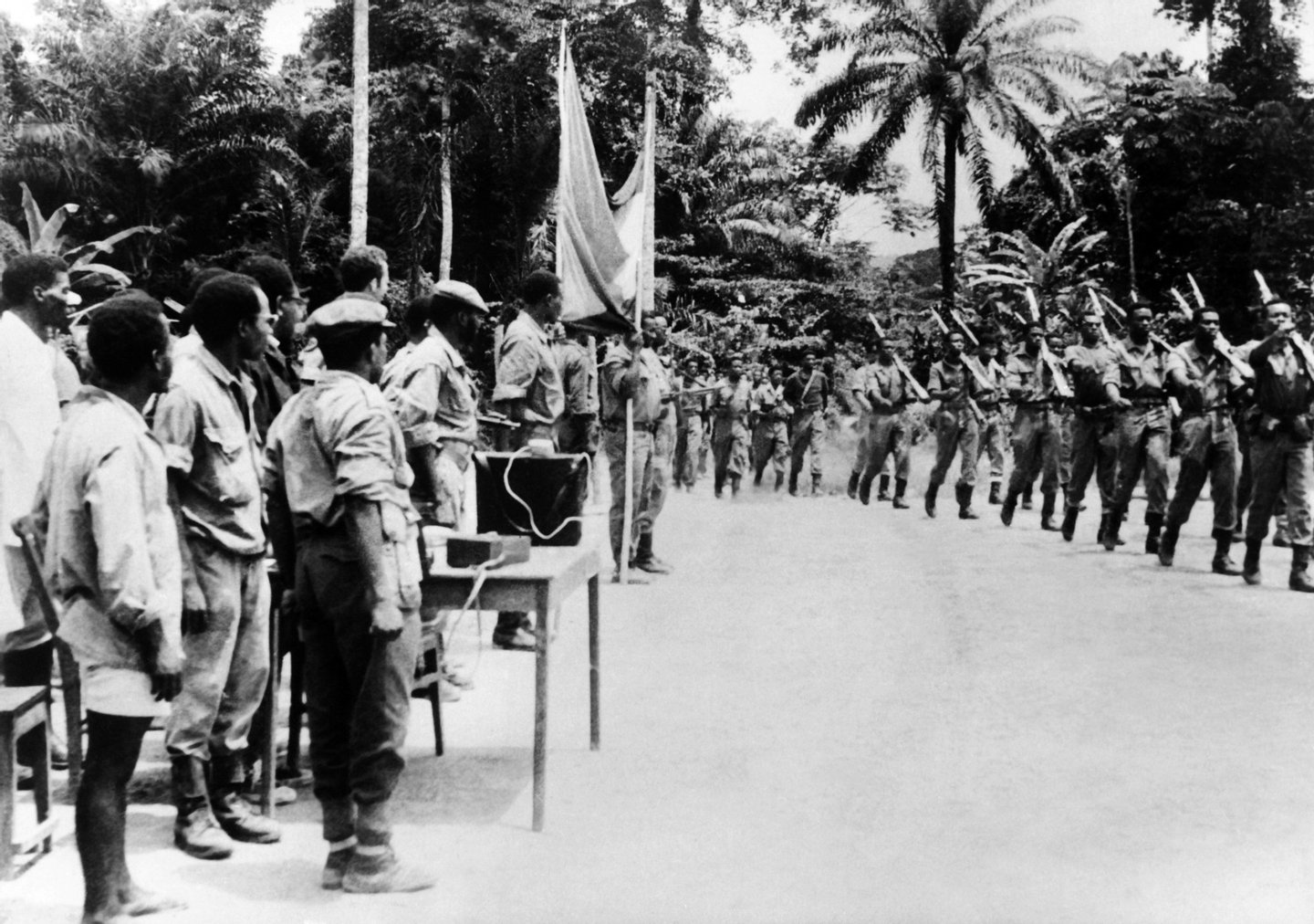 Rebels parade in 1967 in an unlocated place of Angola during the Angolan War of Independence (1961–1975). (Photo credit should read STF/AFP/Getty Images)