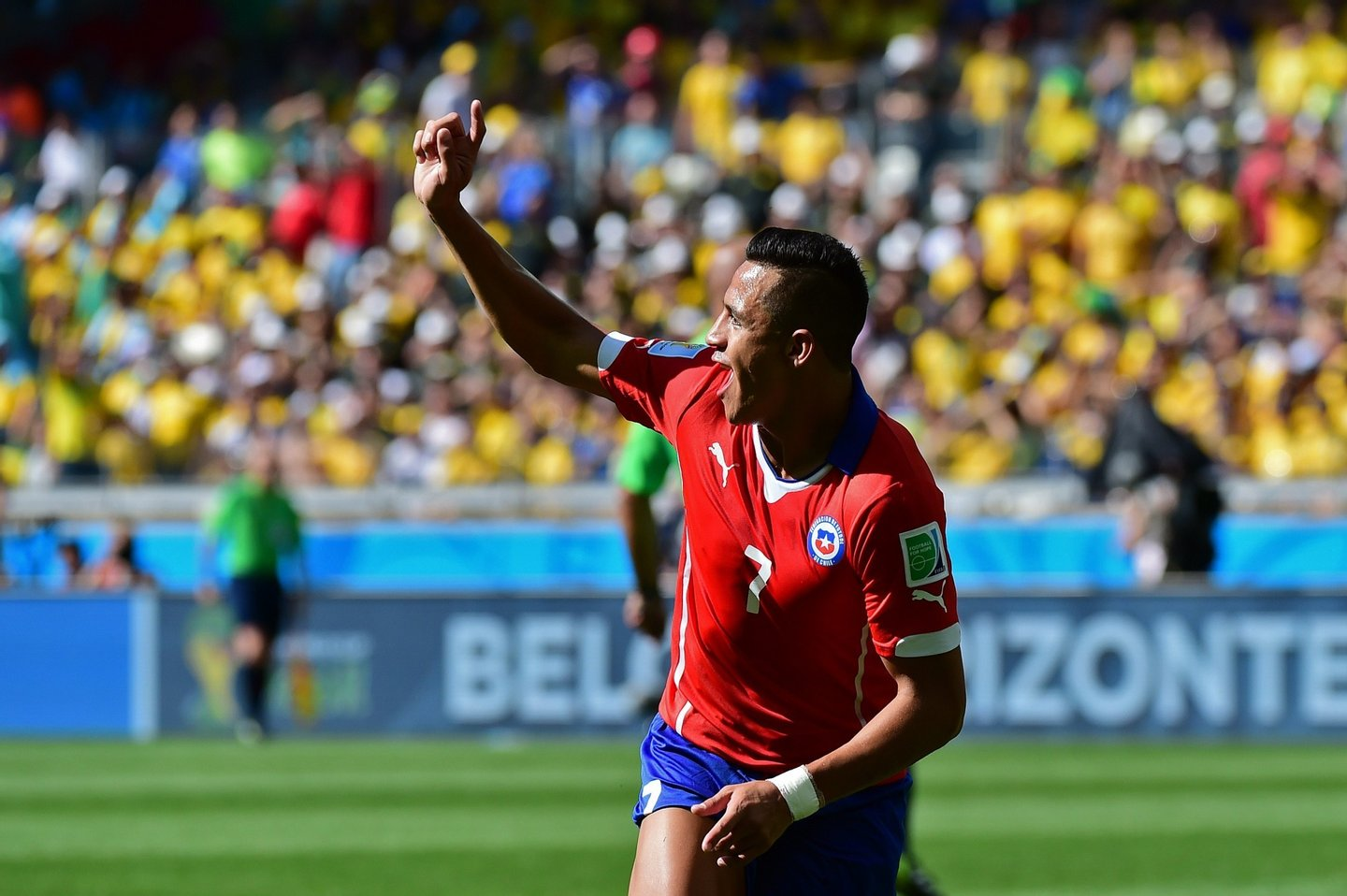 Chile's forward Alexis Sanchez celebrates after scoring a goal during the Round of 16 football match between Brazil and Chile at The Mineirao Stadium in Belo Horizonte during the 2014 FIFA World Cup on June 28, 2014. AFP PHOTO / MARTIN BERNETTI