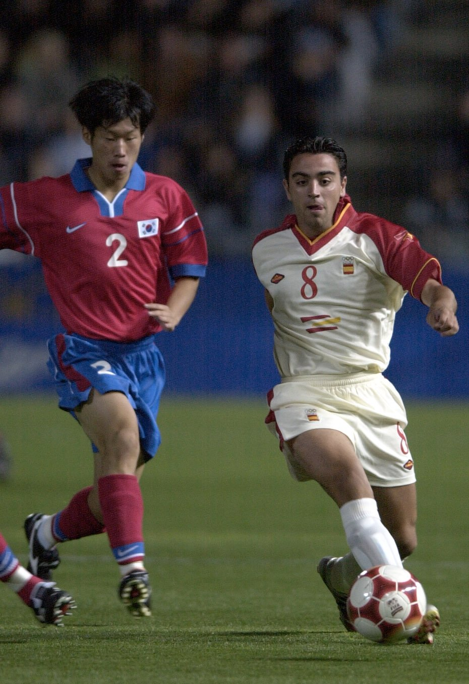 14 Sep 2000:  Park Ji Sung #2 for Korea chases down Xavi #8 for Spain during the Mens Prelimanary Olympic Soccer match between Spain and Korea at the Hindmarsh Stadium, Adelaide, Australia. Spain defeated Korea 3-0.    DIGITAL IMAGE. Mandatory Credit: Robert Cianflone/ALLSPORT