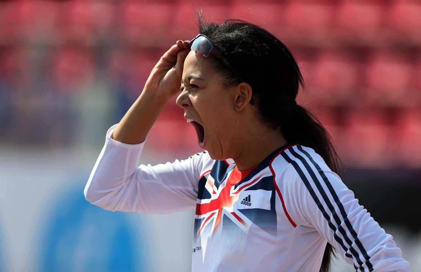 TAMPERE, FINLAND - JULY 13:  Katarina Johnson-Thompson of Great Britain yawns as she waits to competes in the High Jump during The Heptathlon during day three of The European Athletics U23 Championships 2013 on July 13, 2013 in Tampere, Finland. (Photo by Ian MacNicol/Getty Images)
