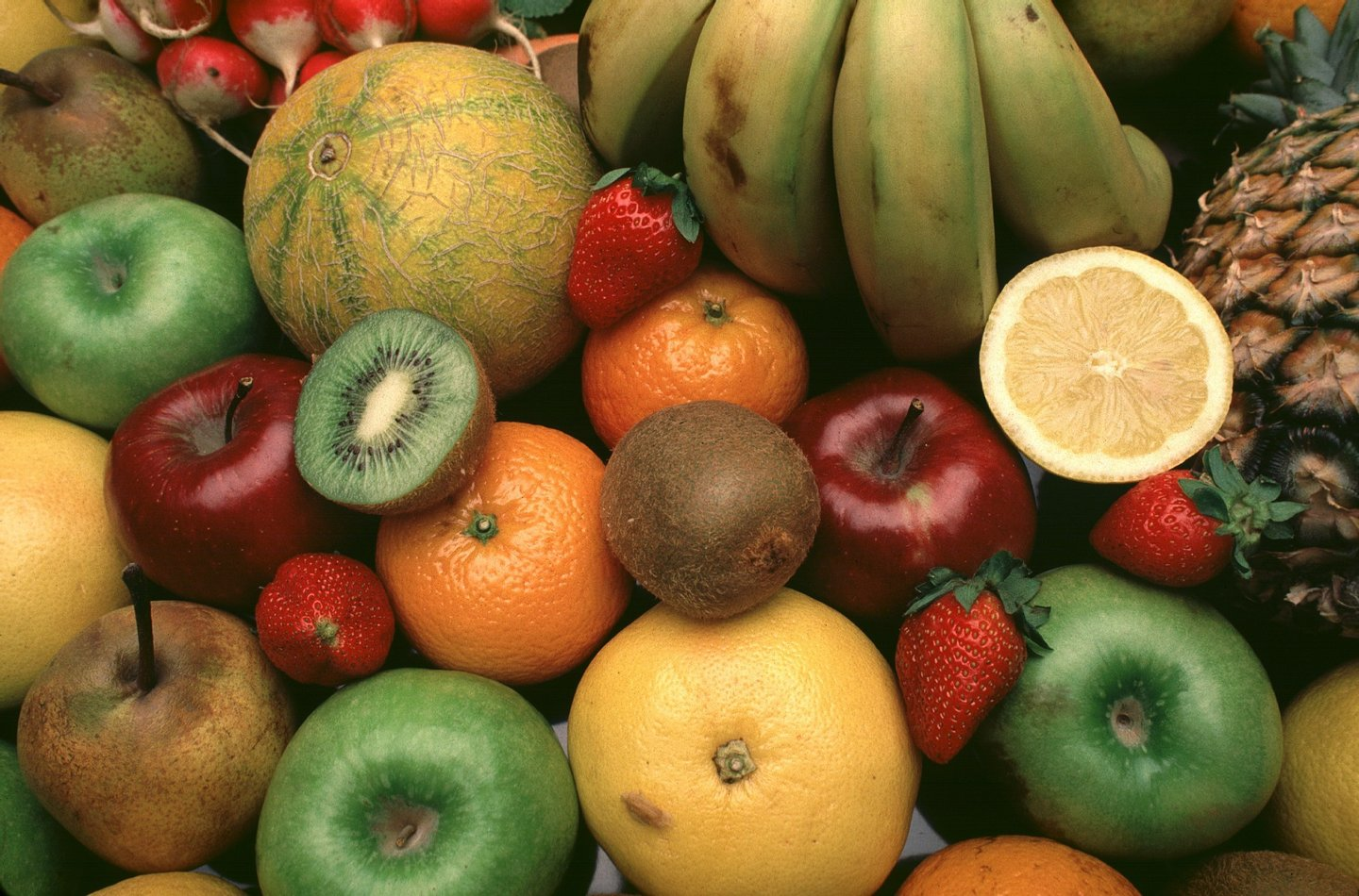 Fruits still life: Oranges, bananas, kiwi, pears, apples, strawberries, pineapple and melon (Photo by Miguel Palacios/Cover/Getty Images)