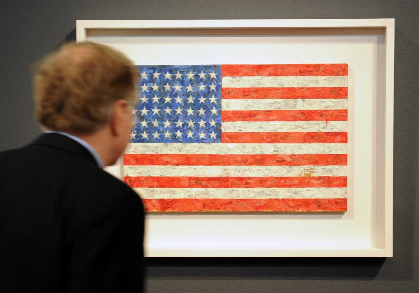 "TO GO WITH AFP STORY US-LIFESTYLE ART by PAOLA MESSANA A man views Jasper Johns' ""Flag"", 1960-66, estimated at USD 10 million to 15 million, on display April 29, 2010 at Christie's in New York. This belongs to the collection of Michael Chrichton, to be sold at the Post-War and Contemporary art evening sale at Christie's May 11.  AFP PHOTO/Stan Honda (Photo credit should read STAN HONDA/AFP/Getty Images)"