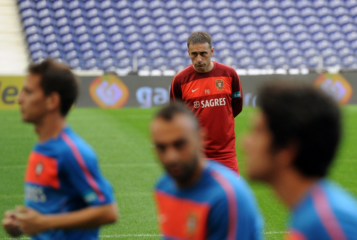 Portugal's coach Paulo Bento (top) looks on as his players train at Dragao Stadium in Porto on October 7, 2010, on the eve of their EURO 2010 qualifyer football match against Denmark. AFP PHOTO/ FRANCISCO LEONG (Photo credit should read FRANCISCO LEONG/AFP/Getty Images)