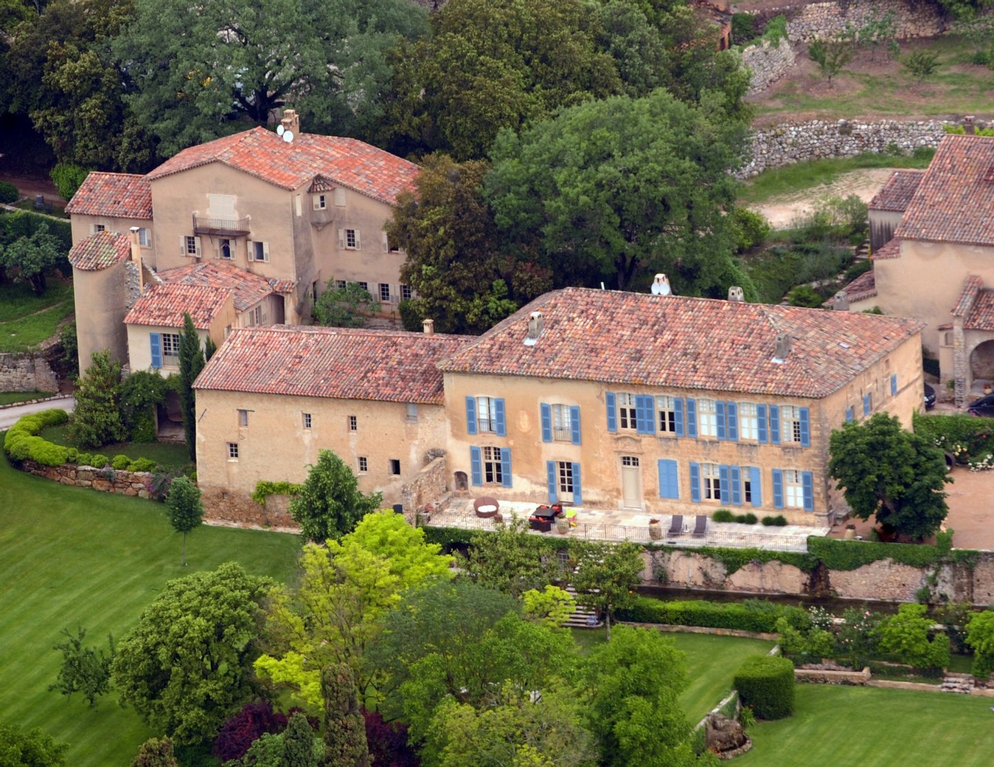 (FILES) A file picture taken on May 31, 2008 in Le Val, southeastern France, shows an aerial view of the Chateau Miraval, a vineyard estate then owned by US businessman Tom Bove, and bought in 2008 by US actors Brad Pitt and Angelina Jolie. The French weekly business newspaper Challenges reported on February 13, 2013 that Pitt and Jolie had decided to take over the exploitation of their vineyard from an outsourced company, in partnership for the grape growing and the winemaking of their 500-hectare wine estate with Marc Perrin and his family -- who produce such wines as Cote du Rhone, Chateauneuf du Pape and Gigondas. The Chateau Miraval wine estate produces wines from Cotes de Provence and Coteaux-Varois-en-Provence. AFP PHOTO MICHEL GANGNE (Photo credit should read MICHEL GANGNE/AFP/Getty Images)