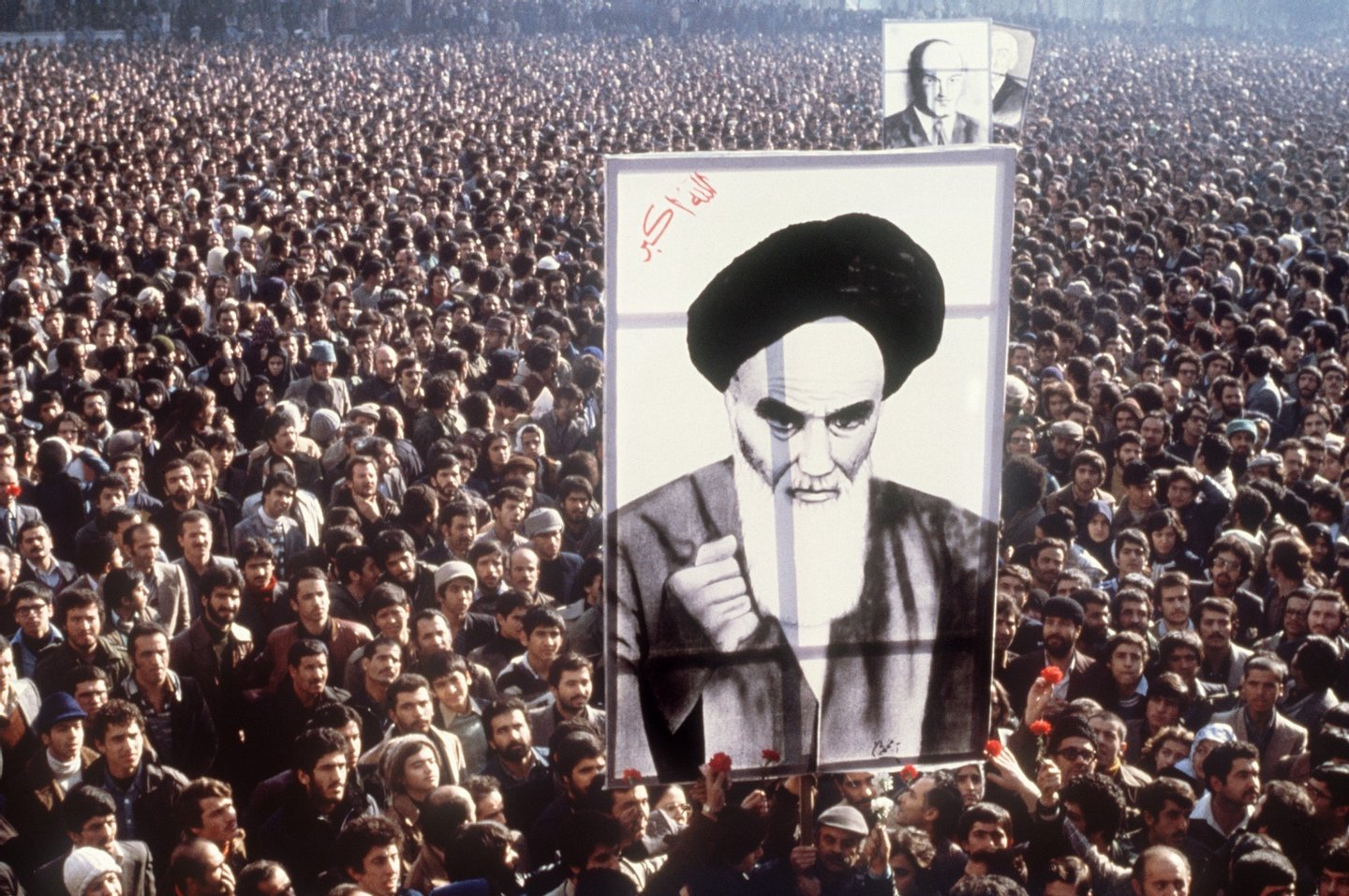 Demonstrators hold a poster of Ayatollah Ruhollah Khomeini, in January 1979, in Teheran, during a demonstration against the shah.        (Photo credit should read /AFP/Getty Images)