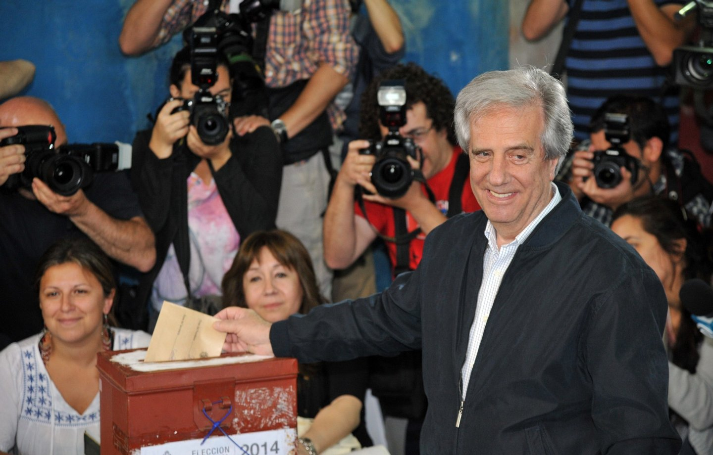 The presidential candidate of the Frente Amplio (Broad Front) party, former president (2005-2010) Tabare Vazquez, casts his vote at a polling station in Montevideo, on October 26, 2014. Polls opened in Uruguay Sunday to elect a successor to folksy iconoclast President Jose Mujica, who remains popular but cannot stand for re-election under term limits. Polling began at 8:00 am (1000 GMT) with Mujica looking to hand power back to his predecessor, cancer doctor Tabare Vazquez of the Broad Front, who needs 50 percent plus one vote to avoid a runoff with Luis Lacalle Pou of the National Party or Pedro Bordaberry, the son of a former dictator who is running on the Colorado ticket.  AFP PHOTO/Guillermo LEGARIA        (Photo credit should read GUILLERMO LEGARIA/AFP/Getty Images)