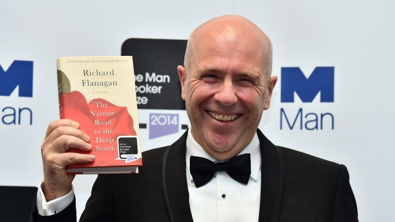 """Australian author Richard Flanagan poses for pictures after winning the 2014 Man Booker Prize for his book """"The Narrow Road to the Deep North"""" in Central London on October 14, 2014. AFP PHOTO/BEN STANSALL        (Photo credit should read BEN STANSALL/AFP/Getty Images)"""