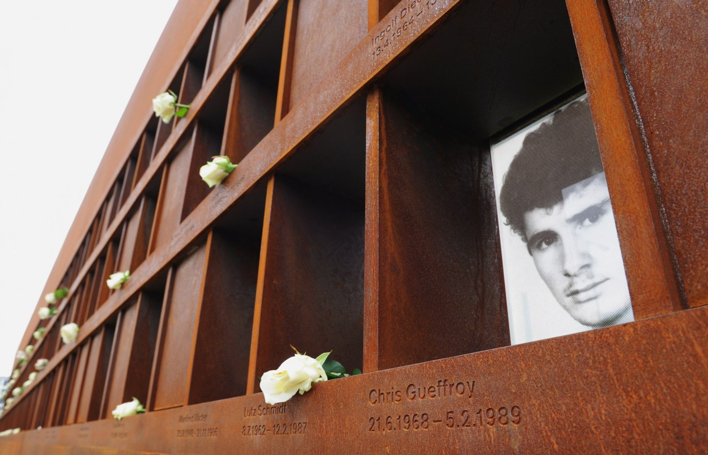 The picture of Chris Gueffroy, last victim killed by weapons, can be seen at the memorial site at Bernauer Strasse in Berlin August 13, 2010. Berlin marks the 49th anniversary of the construction of the Berlin Wall on August 13, 2010. AFP PHOTO / JOHANNES EISELE (Photo credit should read JOHANNES EISELE/AFP/Getty Images)