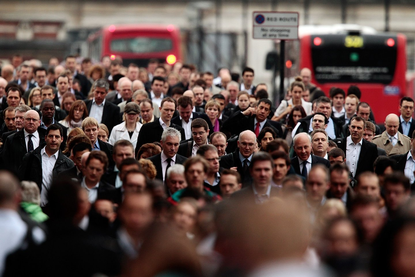 LONDON, ENGLAND - OCTOBER 04: Commuters walk across London Bridge during morning rush hour on October 4, 2010 in London, England. London Underground workers are staging a 24 hour walk out over concerns at plans to cut jobs, causing large disruption to the capitals transport network. (Photo by Matthew Lloyd/Getty Images)