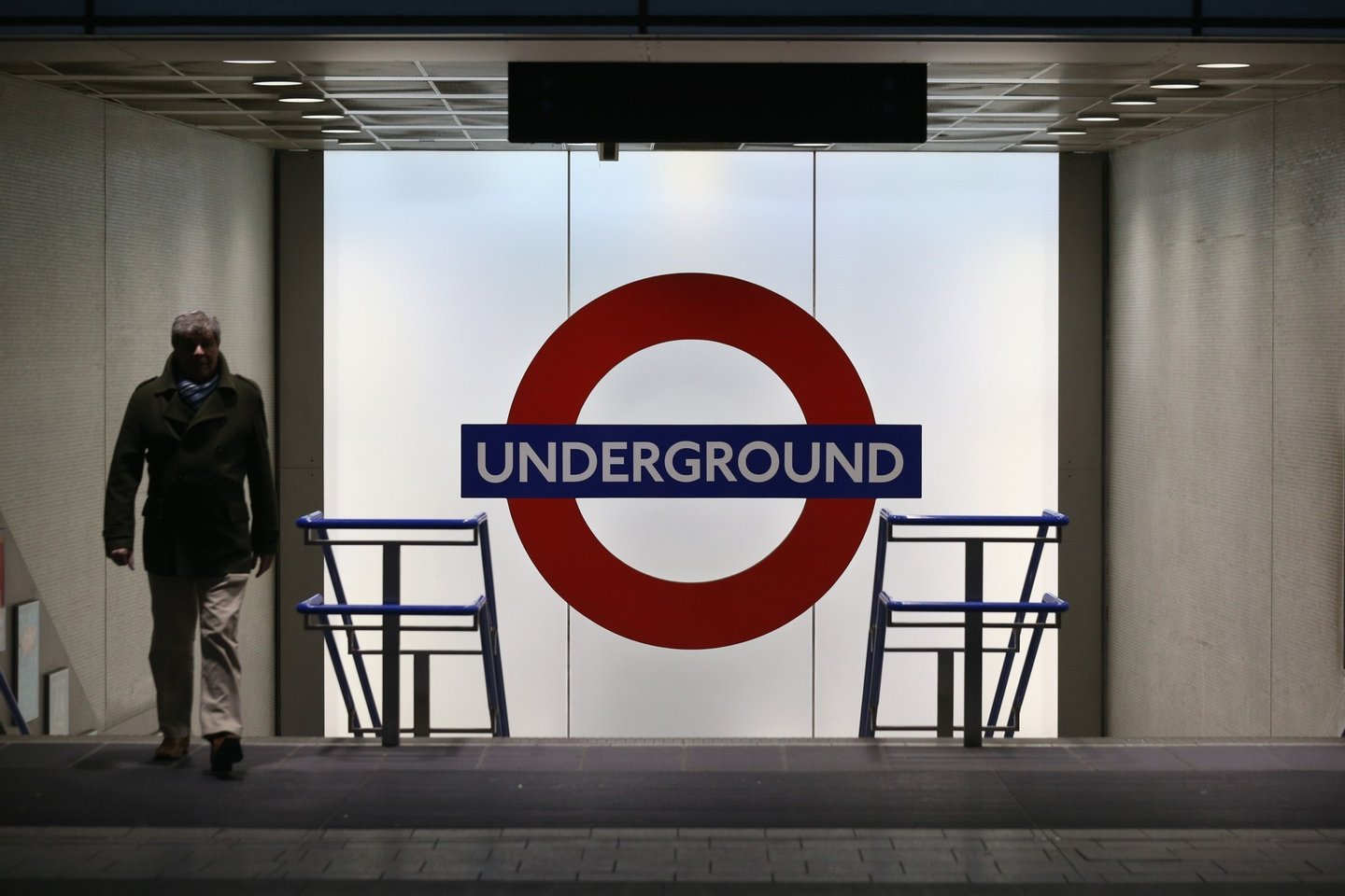 LONDON, UNITED KINGDOM - DECEMBER 23: Members of the public use the London Underground in Kings Cross Station on December 23, 2013 in London, England. With two days until Christmas day, heavy rain and strong winds are affecting much of southern England with numerous Met office weather warnings in place. Road, rail and ferry routes have been affected by the weather with gusts of wind and flooding anticipated in some areas. (Photo by Oli Scarff/Getty Images)