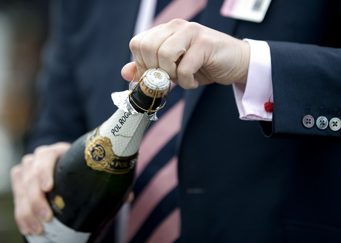 CHESTER, ENGLAND - MAY 10: Opening of a bottle in the champagne bar at Chester racecourse on May 10, 2012 in Chester, England. (Photo by Alan Crowhurst/Getty Images)