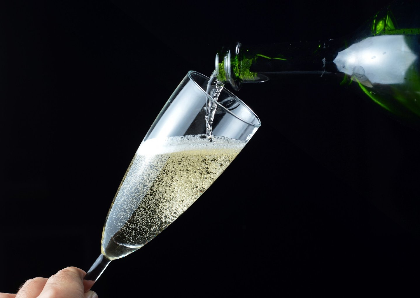 A picture taken on December 31, 2012 in Paris shows a glass being filled up with champagne ahead of the New Year celebrations. AFP PHOTO MIGUEL MEDINA        (Photo credit should read MIGUEL MEDINA/AFP/Getty Images)