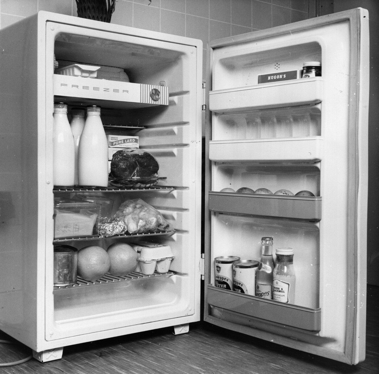 An open refrigerator full of food.   (Photo by Fox Photos/Getty Images)