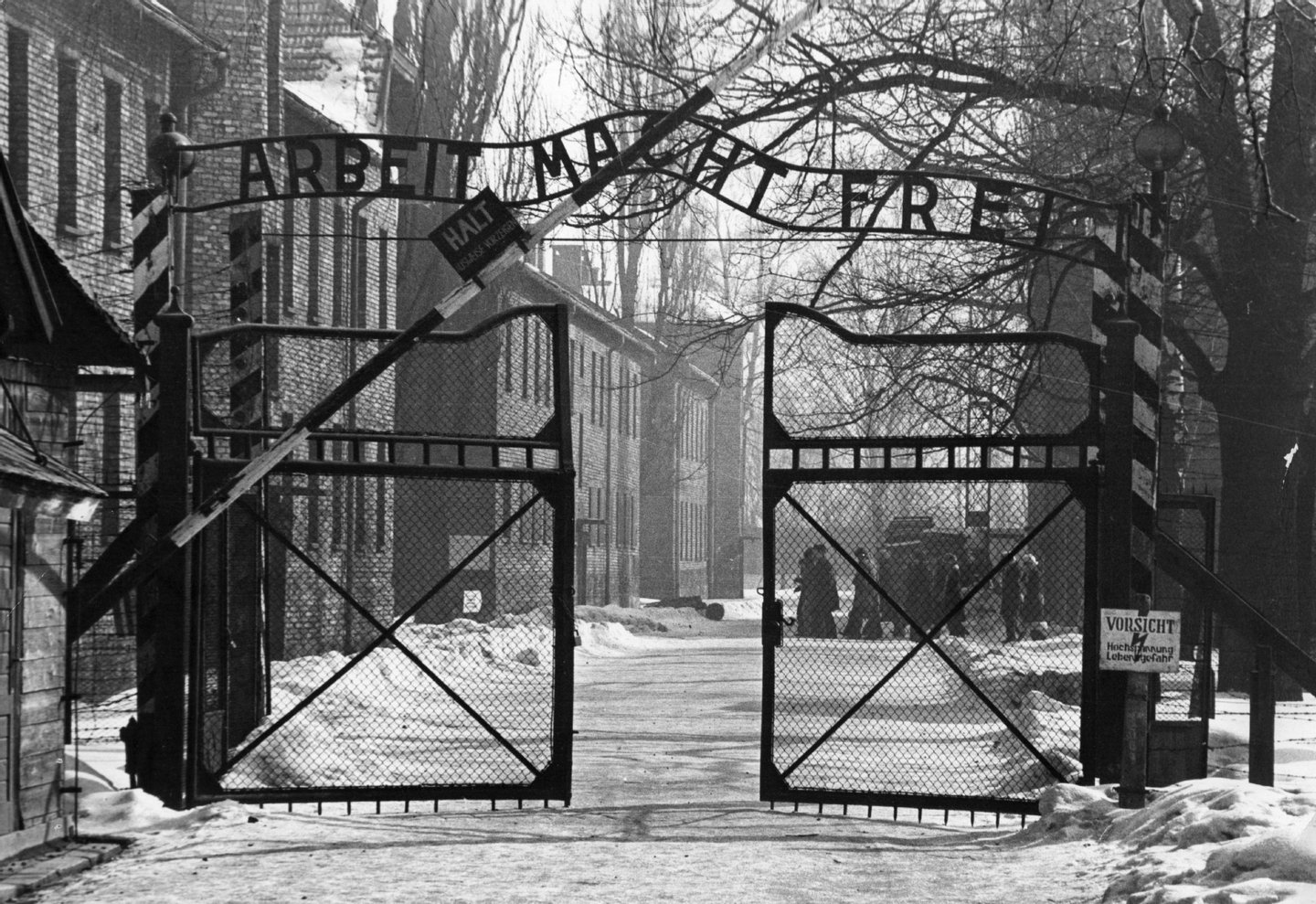 The gates of the Nazi concentration camp at Auschwitz, Poland, circa 1965. The sign above them is 'Arbeit Macht Frei' - 'Work Makes You Free'. (Photo by Keystone/GettyImages)