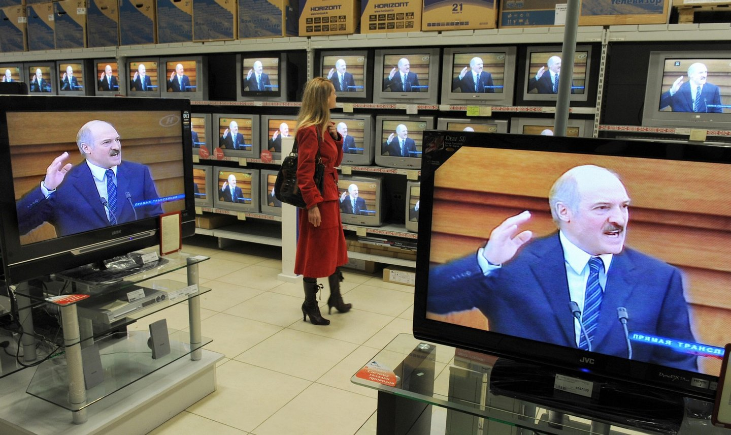 "A Belarussian woman watches President Alexander Lukashenko giving his annual address on television at a Minsk electronics store on April 23, 2009. Belarussians should work ""day and night"" to help the country emerge from the economic crisis, President Alexander Lukashenko said.                   AFP PHOTO / VIKTOR DRACHEV (Photo credit should read VIKTOR DRACHEV/AFP/Getty Images)"