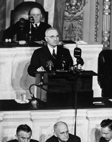 US President Harry S. Truman (1884 - 1972) speaking to Congress from the rostrum in the House of Representatives, behind him is the Democratic Speaker of the House Sam Rayburn (1882 - 1961), October 23, 1945.  (Photo by Keystone/Getty Images)