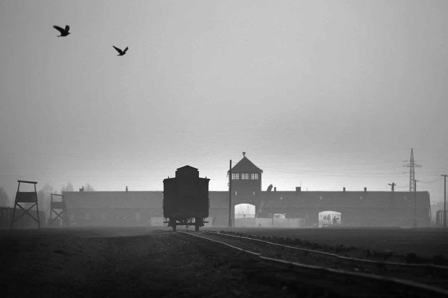 OSWIECIM, POLAND - NOVEMBER 13: The railway track leads to the infamous 'Death Gate' at the Auschwitz II Birkenau extermination camp on November 13, 2014 in Oswiecim, Poland. Ceremonies marking the 70th anniversary of the liberation of the camp by Soviet soldiers are due to take place on January 27, 2015. Auschwitz was a network of concentration camps built and operated in occupied Poland by Nazi Germany during the Second World War. Auschwitz I and nearby Auschwitz II-Birkenau was the extermination camp where an estimated 1.1 million people, mostly Jews from across Europe, were killed in gas chambers or from systematic starvation, forced labour, disease and medical experiments. (Photo by Christopher Furlong/Getty Images)