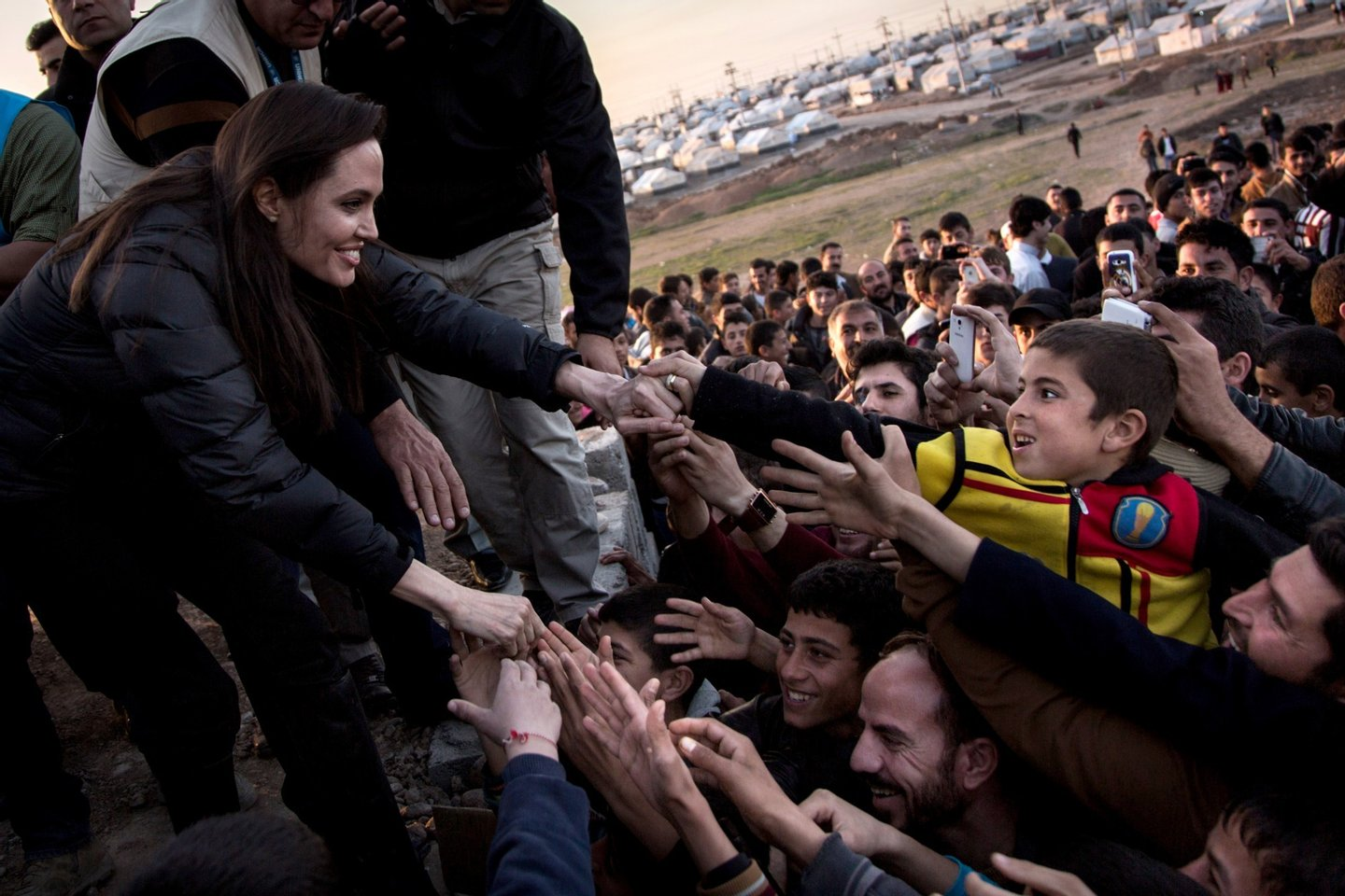 KHANKE, IRAQ - JANUARY 25: In this handout image provided by UNHCR, UNHCR Special Envoy Angelina Jolie meets members of the Yazidi minority in Khanke IDP Camp on January 25, 2015 in Khanke, Iraq. Angelina Jolie was visiting Syrian refugees and displaced Iraqi citizens in the Kurdistan Region of Iraq to offer support to 3.3 million displaced people in the country and highlight their dire needs. (Photo by Andrew McConnell/UNHCR via Getty Images)
