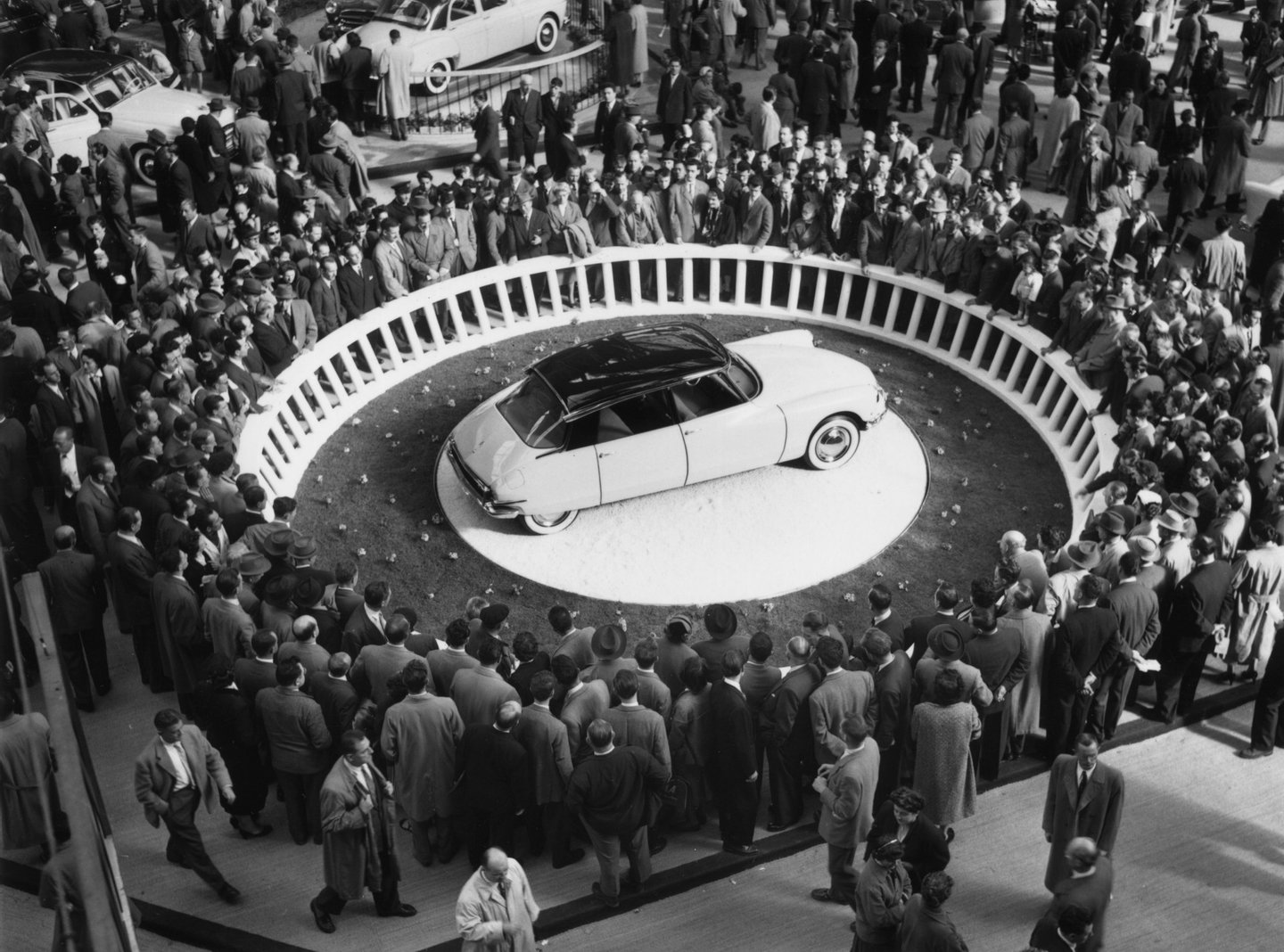 Crowds at the Paris Motor Show in the Grand Palais surround a Citroen DS-19 on display. (Photo by Keystone/Getty Images)