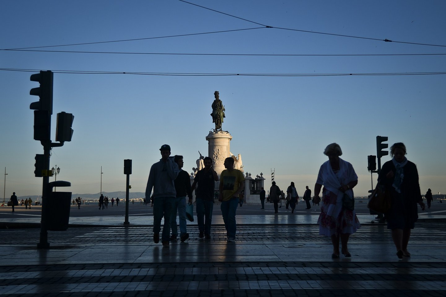 A picture taken on April 28, 2014 shows people passing by Terreiro do Paco Square in downtown Lisbon. AFP PHOTO / PATRICIA DE MELO MOREIRA (Photo credit should read PATRICIA DE MELO MOREIRA/AFP/Getty Images)