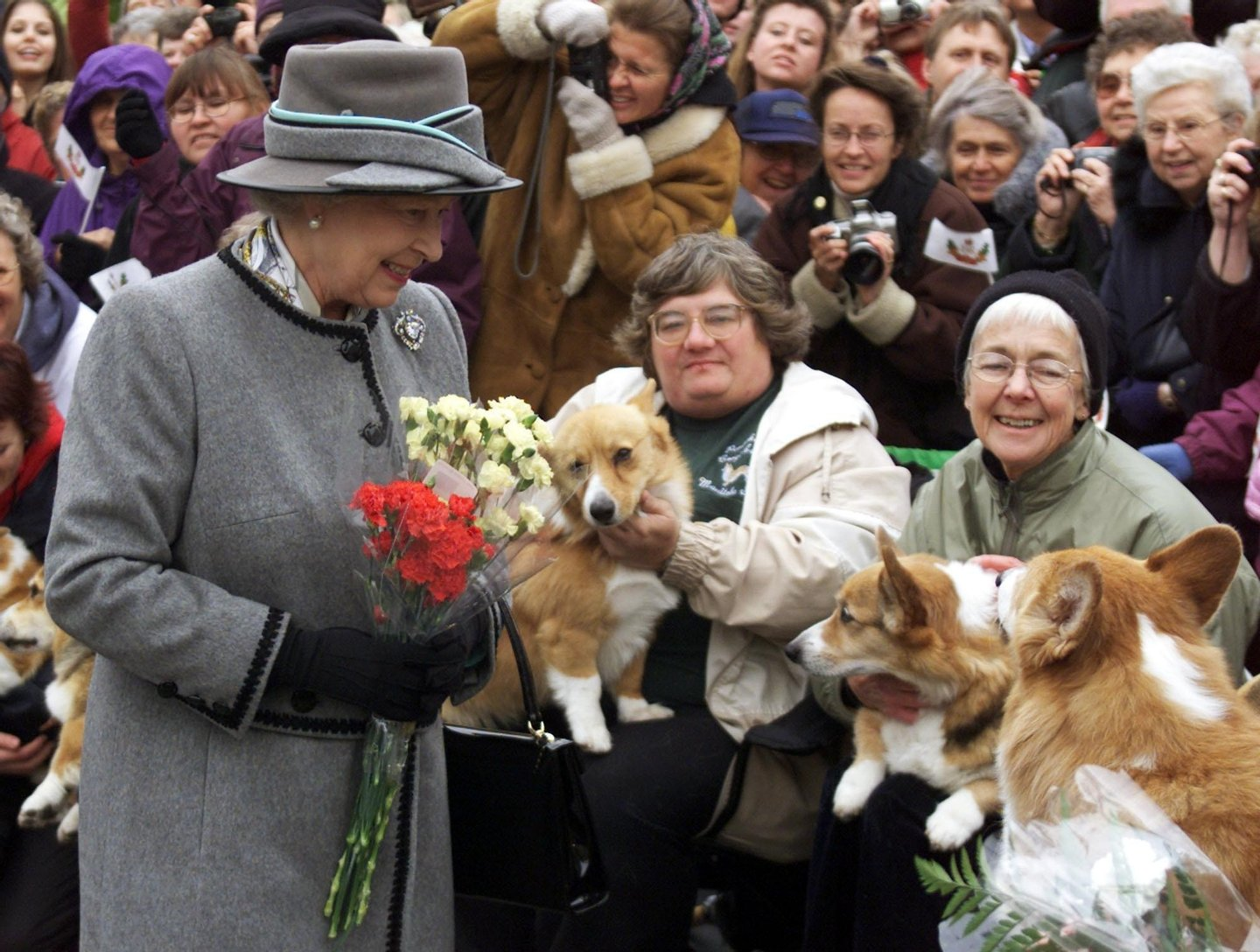 WINNIPEG, CANADA: Queen Elizabeth II talks with members of the Manitoba Corgi Association during a visit to Winnipeg 08 October 2002. The queen, making her 20th trip to Canada, is the last stop on the year-long jubilee tour celebrating her 50-year reign. AFP PHOTO/POOL/Adrian WYLD (Photo credit should read ADRIAN WYLD/AFP/Getty Images)