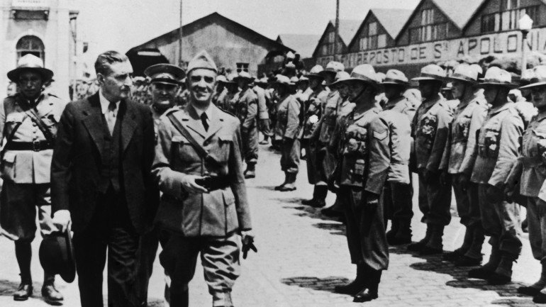 Portuguese dictator Antonio De Oliveira Salazar (1889 - 1970) reviews troops about to embark for the African colonies of the Portuguese Republic, circa 1950. (Photo by Evans/Three Lions/Hulton Archive/Getty Images)