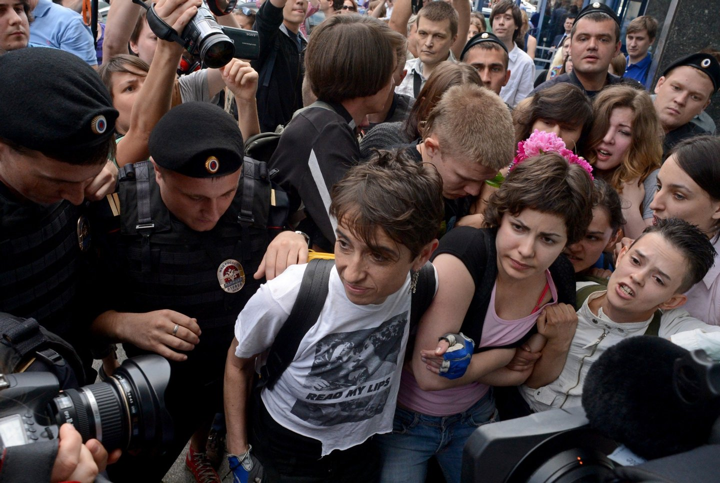 "Masha Gessen (L) and other Russian gay rights activists protest outside the lower house of Russias parliament, the State Duma, in Moscow, on June 11, 2013. Russia's parliament debated today a law introducing steep fines and jail terms for people who promote homosexual ""propaganda"" to minors, a measure critics fear will be used to justify the repression of gays amid rising homophobia in the country. AFP PHOTO / KIRILL KUDRYAVTSEV        (Photo credit should read KIRILL KUDRYAVTSEV/AFP/Getty Images)"