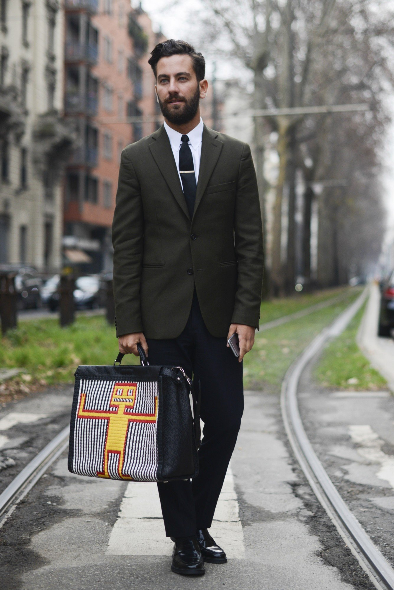 MILAN, ITALY - JANUARY 19: Matthew Zorpas poses wearing an Acne suit and Fendi bag during day 3 of Milan Menswear Fashion Week Fall/Winter 2015/2016  on January 19, 2015 in Milan, Italy.  (Photo by Vanni Bassetti/Getty Images)