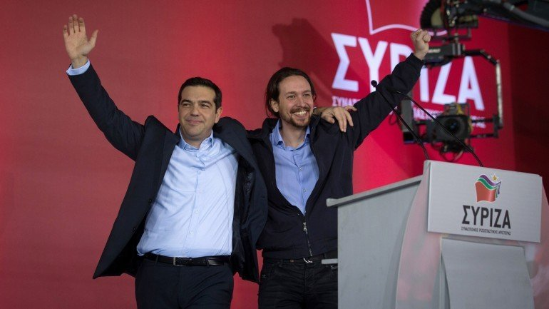 ATHENS, GREECE - JANUARY 22:  Alexis Tsipras, leader of the radical leftist Syriza party is joined by Spanish Podemos party Secretary General Pablo Iglesias (R) as he campaigns at a pre-election rally ahead of this weekend's general election on January 22, 2015 in Athens, Greece. According to the latest opinion polls, the left-wing Syriza party are poised to defeat Prime Minister Antonis Samaras' conservative New Democracy party in the election, which will take place on Sunday. European leaders fear that Greece could abandon the Euro, write off some of its national debt and put an end to the country's austerity by renegotiating the terms of its bailout if the radical Syriza party comes to power. Greece's potential withdrawal from the eurozone has become known as the 'Grexit'.  (Photo by Matt Cardy/Getty Images)