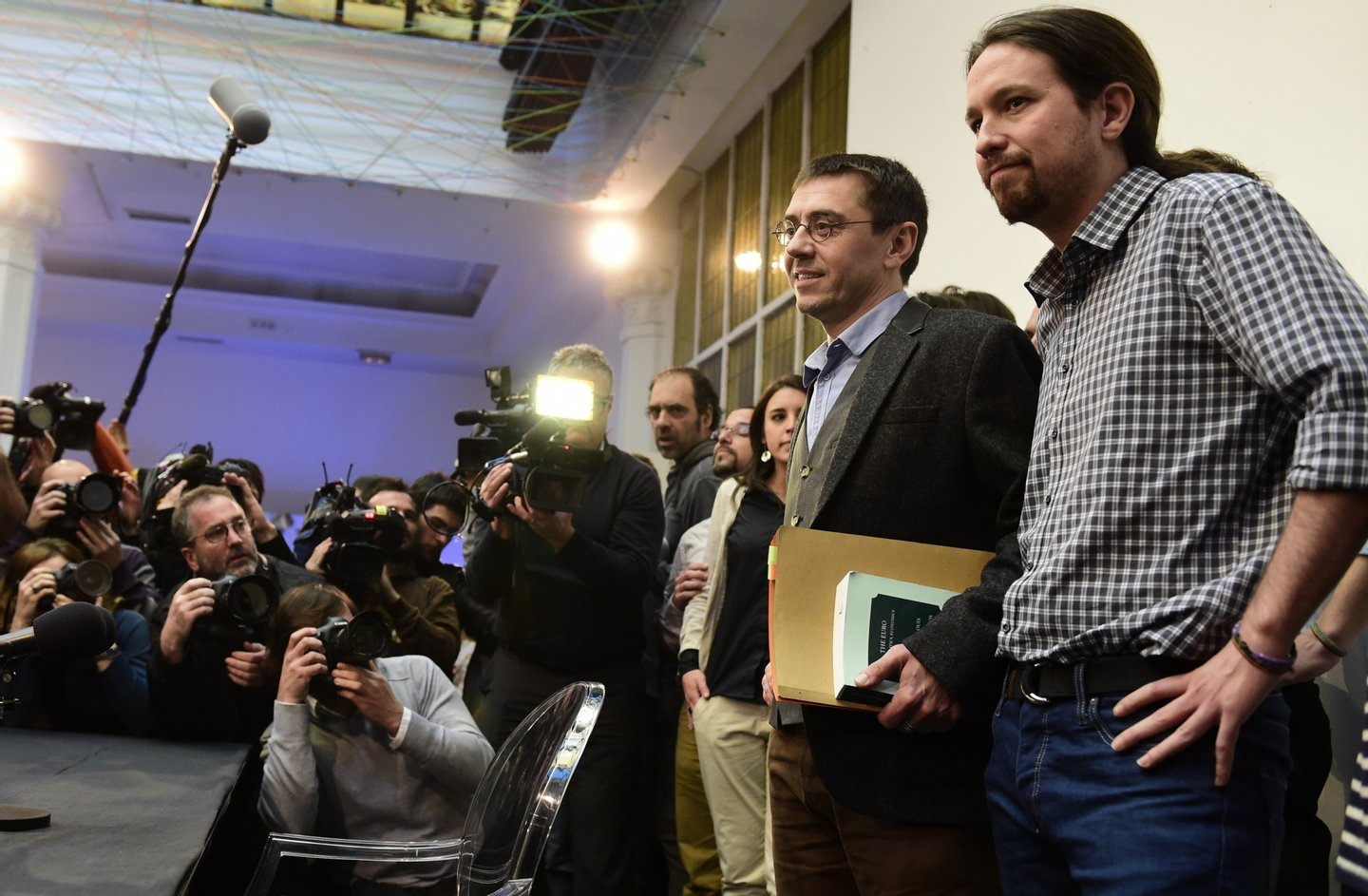 Spanish leader of Podemos Pablo Iglesias (R) and Spanish Secretary of Constituent Process and Programme of Podemos, Juan Carlos Monedero (2nd R), pose for photographers prior to giving a press conference in Madrid on February 20, 2015. Political science professor and founder of Podemos, Juan Carlos Monedero, finds himself embroiled in allegations of tax irregularities that forced him to publish his bank statements in an effort to silence critics.  AFP PHOTO / JAVIER SORIANO        (Photo credit should read JAVIER SORIANO/AFP/Getty Images)