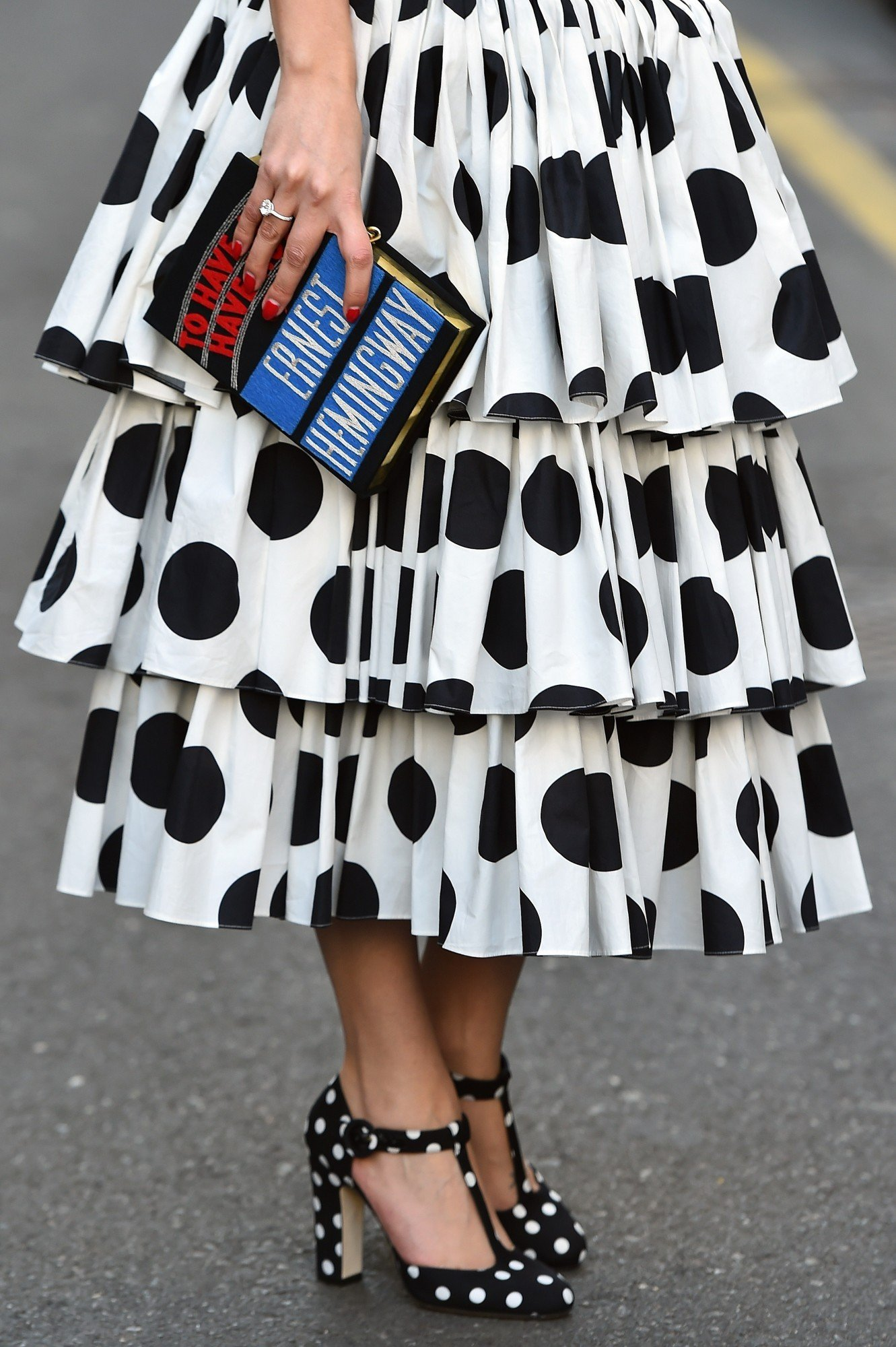 Model Lise Grendene poses in the street before the show for fashion house Dolce & Gabbana at the women Fall / Winter 2015/16 Milan's Fashion Week on March 1, 2015.  AFP PHOTO / GABRIEL BOUYS        (Photo credit should read GABRIEL BOUYS/AFP/Getty Images)