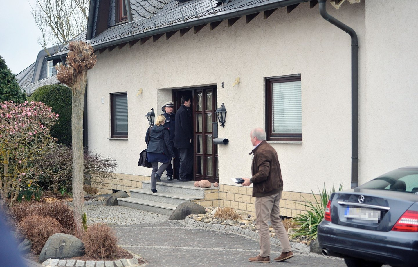 MONTABAUR, GERMANY - MARCH 26:  Police stand in front of the residence of the parents of Andreas Lubitz, co-pilot on Germanwings flight 4U9525, on March 26, 2015 in Montabaur, Germany. French authorities confirmed that Lubitz was alone in the cockpit during the rapid descent of flight 4U9525 until it crashed into mountains in southern France two days ago, killing all 150 people on board. Authorities are pursuing the possibility that Lubitz might have acted deliberately in steering the aircraft to its destruction.  (Photo by Thomas Lohnes/Getty Images)