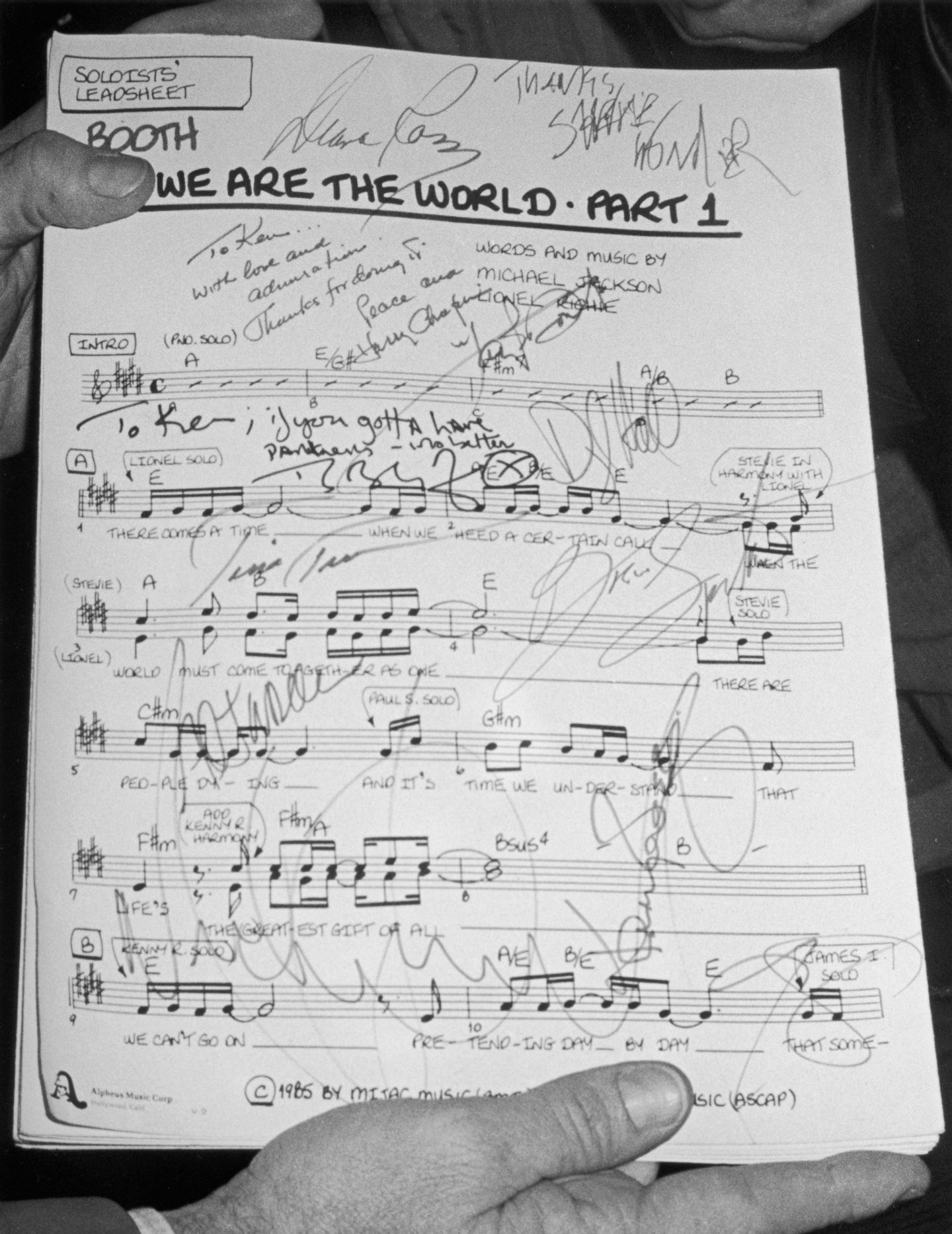 Viwe of the autographed first page of the sheet music for the song 'We Are the World,' written by Michael Jackson and Lionel Richie, 1985. The song was designed to raise awareness and funds for a worldwide hunger relief program, and its international success led the way for the Live Aid concerts later that year. (Photo by Hulton Archive/Getty Images)
