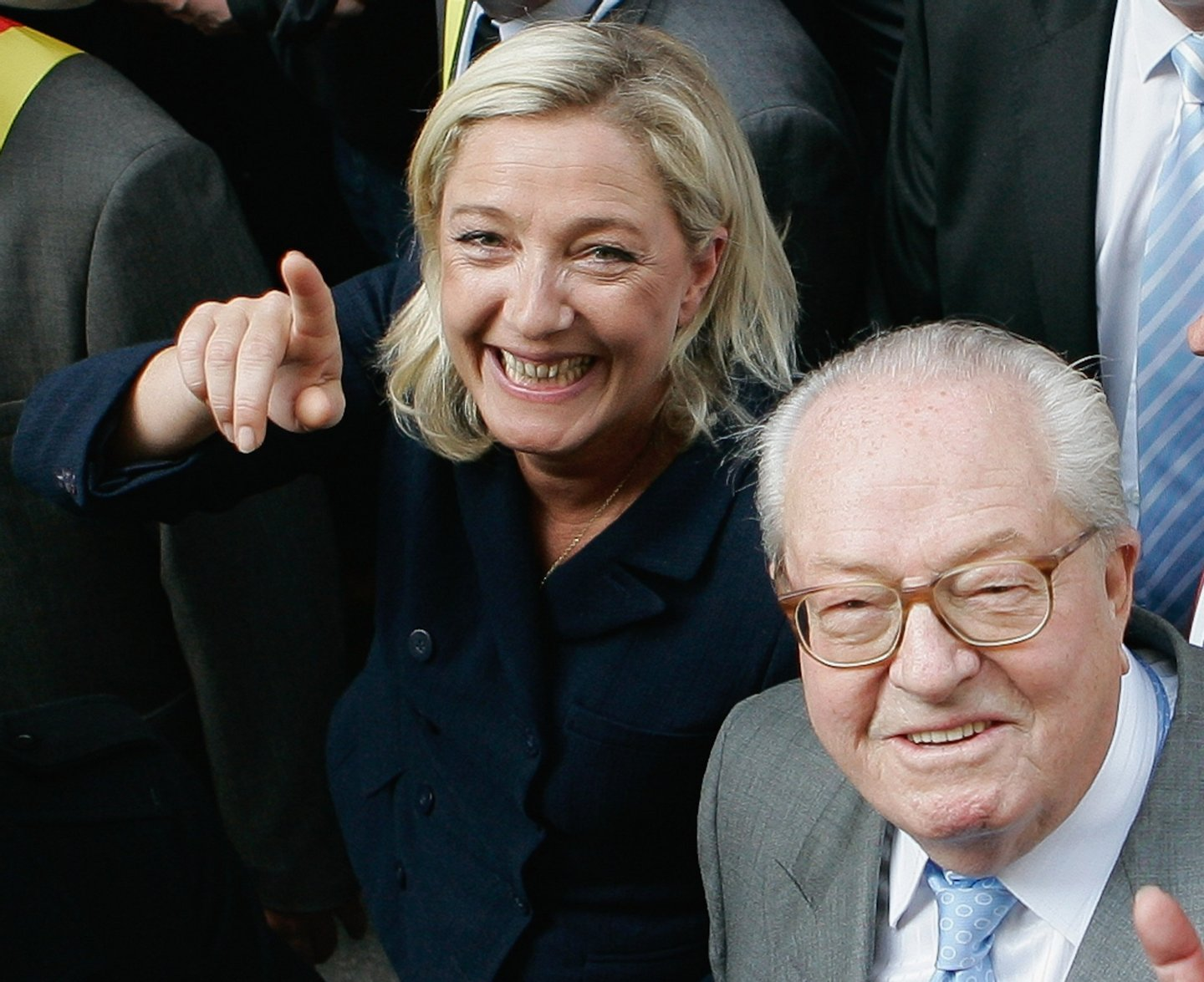 PARIS, FRANCE - MAY 01:  France's far-right National Front President,  Marine Le Pen (L) and her father Jean-Marie Le Pen take part in a march as part of the party's annual celebration of Joan of Arc on May 1, 2011 in Paris, France. France's far-right National Front members took part in its traditional Joan of arc May Day Rally with the party's new leader, as thousands across the globe took to the streets to rally for worker's rights on International Workers' Day.  (Photo by Franck Prevel/Getty Images)