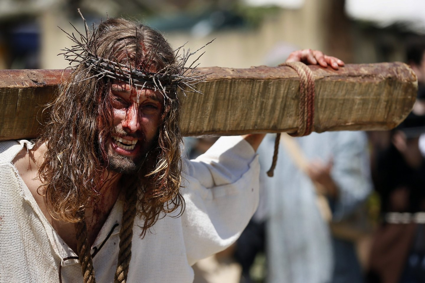 An actor performs the Passion of Christ during Good Friday, in Castro Urdiales, province of Cantabria in northern Spain on April 18, 2014. Living Passion is a representation of the Passion of Christ from the last supper to his crucifixion, death and resurrection.   AFP PHOTO/ CESAR MANSO        (Photo credit should read CESAR MANSO/AFP/Getty Images)