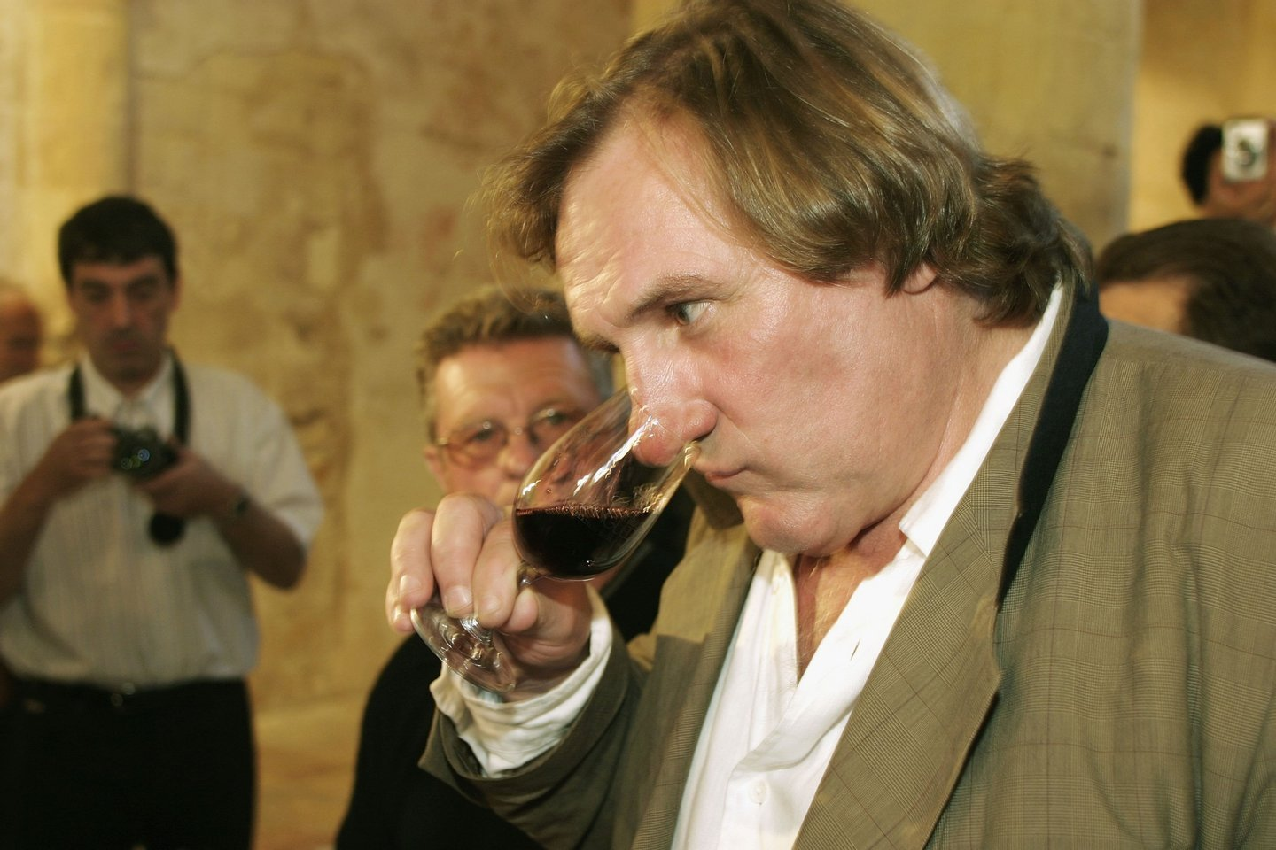 "ANIANE, FRANCE - MAY 23: Actor Gerard Depardieu (along with his partner Bernard Magrez) presents his new 2004 vin de garage vintage wine called ""Le bien decide"" at his 3 hectare vineyard ""Coteaux du Languedoc"" in Aniane, near Montpellier, on May 23, 2005 in Aniane, France. (Photo by Pascal Parrot/Getty Images)"