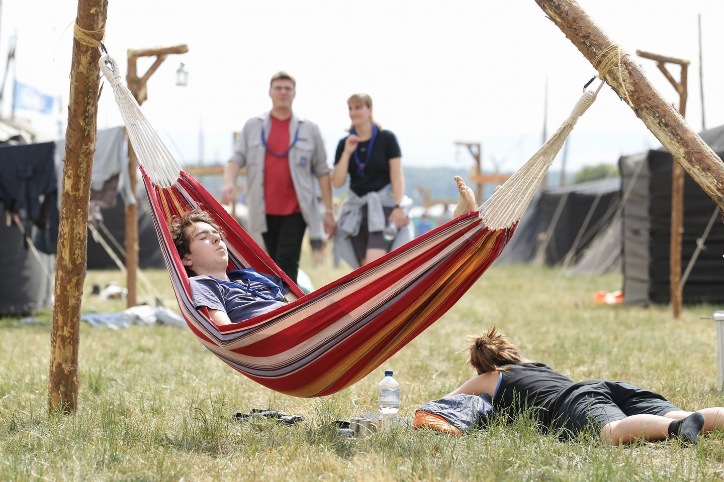 ALMKE, GERMANY - JULY 31:  A scout enjoys the sun in his hammock at the camp on July 31, 2010 in Almke near Wolfsburg, Germany. About 5000 young scouts from Germany, Russia, Belgium, Suisse, USA and Italy aged 12 to 20 participate in a camp. Since 1973, the German VCP-Christian Guides and Pathfinders organisation, offers an International historic boys and girls scout meeting during the summer holidays. On a 25 hectare field include 1370 tens, a tent church and a tent theater. The Federal camp is held every four years.  (Photo by Andreas Rentz/Getty Images)