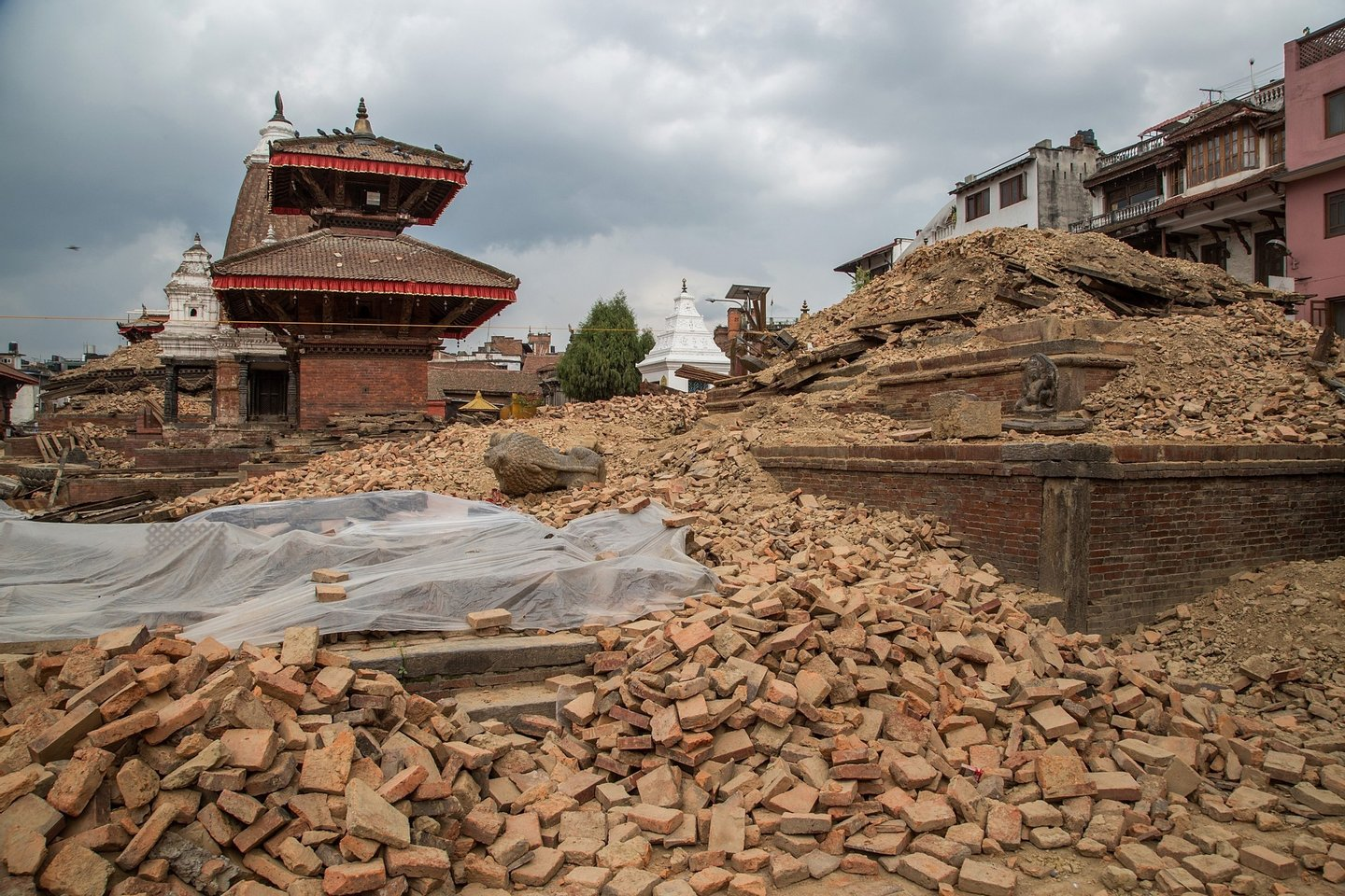 LALITPUR, NEPAL - APRIL 28:  Remains of a collapsed temple in the UNESCO World Heritage Site of Patan Durbar Square on April 28, 2015 in Lalitpur, Nepal. A major 7.8 earthquake hit Kathmandu mid-day on Saturday, and was followed by multiple aftershocks that triggered avalanches on Mt. Everest that buried mountain climbers in their base camps. Many houses, buildings and temples in the capital were destroyed during the earthquake, leaving thousands dead or trapped under the debris as emergency rescue workers attempt to clear debris and find survivors. Regular aftershocks have hampered recovery missions as locals, officials and aid workers attempt to recover bodies from the rubble.  (Photo by Omar Havana/Getty Images)