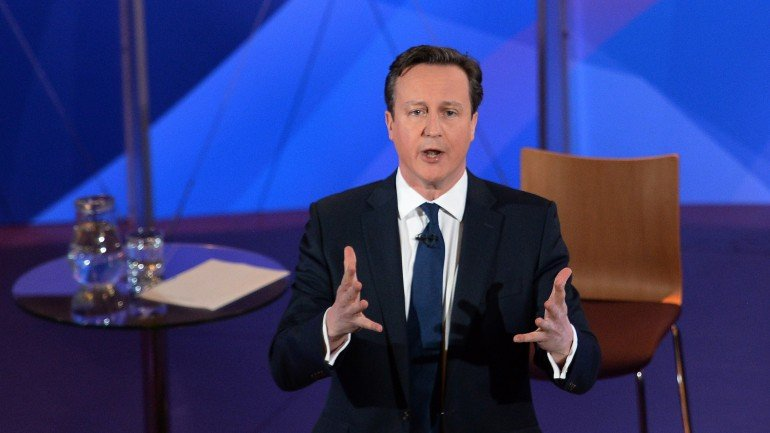 "British Prime Minister and leader of the Conservative Party, David Cameron takes part in the ""BBC Question Time: Election Leaders Special"" television program at Leeds Town Hall in Leeds, northern England on April 30, 2015. Opinion polls show Prime Minister David Cameron's centre-right Conservatives neck and neck with the main centre-left opposition Labour Party, which is led by Ed Miliband.   AFP PHOTO / POOL / STEFAN ROUSSEAU        (Photo credit should read STEFAN ROUSSEAU/AFP/Getty Images)"