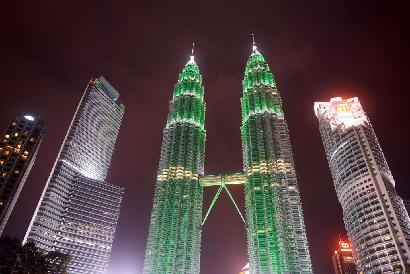 A general view shows the lights of the Petronas towers in Kuala Lumpur before being switched off for earth hour on March 29, 2014. Lights went off in thousands of cities and towns across the world on for the annual Earth Hour campaign, which is aiming to raise money via the Internet for local environmental projects. AFP PHOTO / Ed Jones        (Photo credit should read ED JONES/AFP/Getty Images)