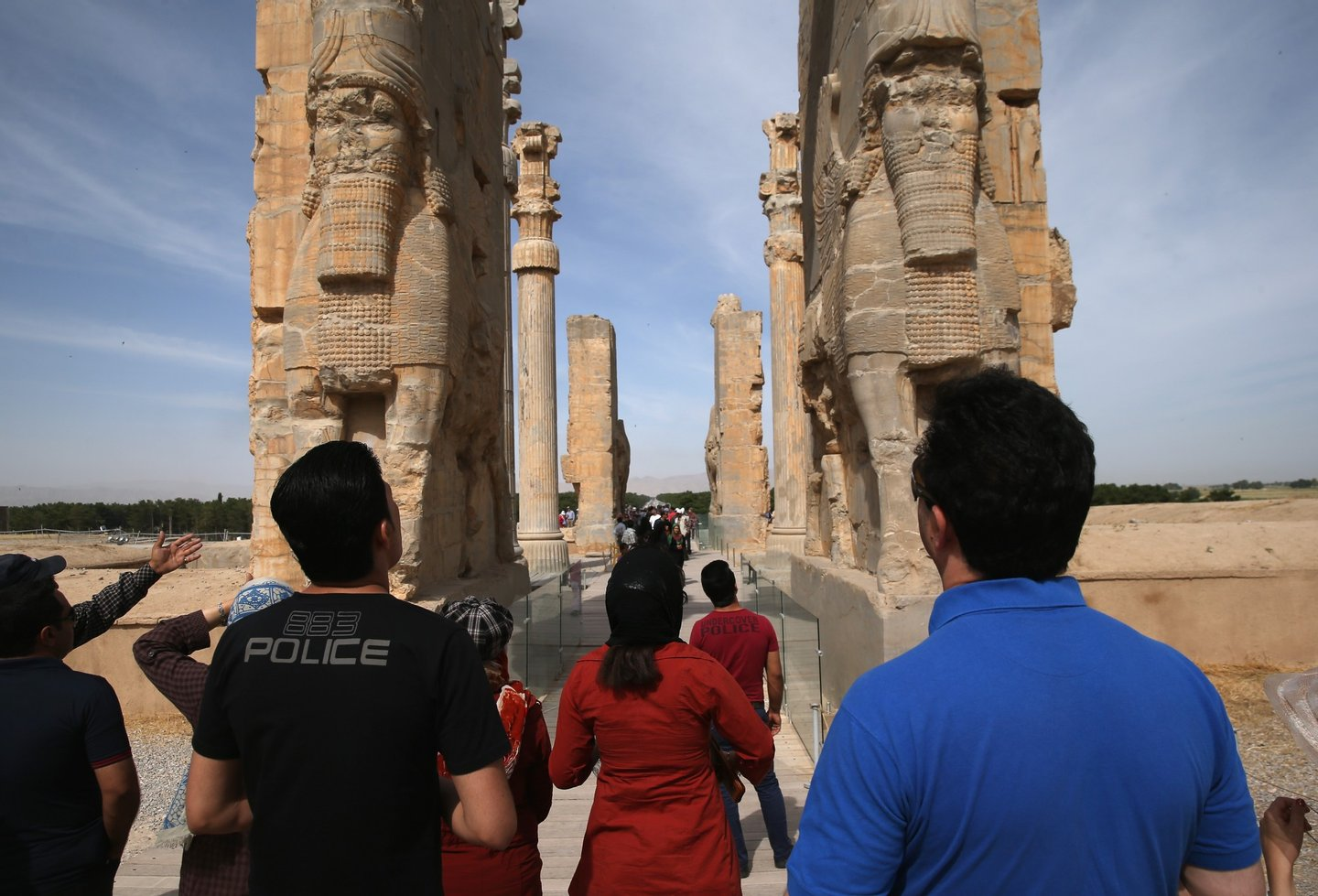 PERSEPOLIS, IRAN - MAY 30:  Tourists gaze upon the Gate of All Nations at the ancient Persepolis archeological site on May 30, 2014 in Persepolis, Iran. The ruins mark the site of the 6th century BC Persian Achaemenid Empire, the largest empire the world had known up to that time, eventually ended by Alexander the Great. This week marks the 25th anniversary of the death and continued legacy of the Ayatollah Khomeini, the father of Iran's Islamic Revolution, only the latest chapter of Persia's long history.  (Photo by John Moore/Getty Images)