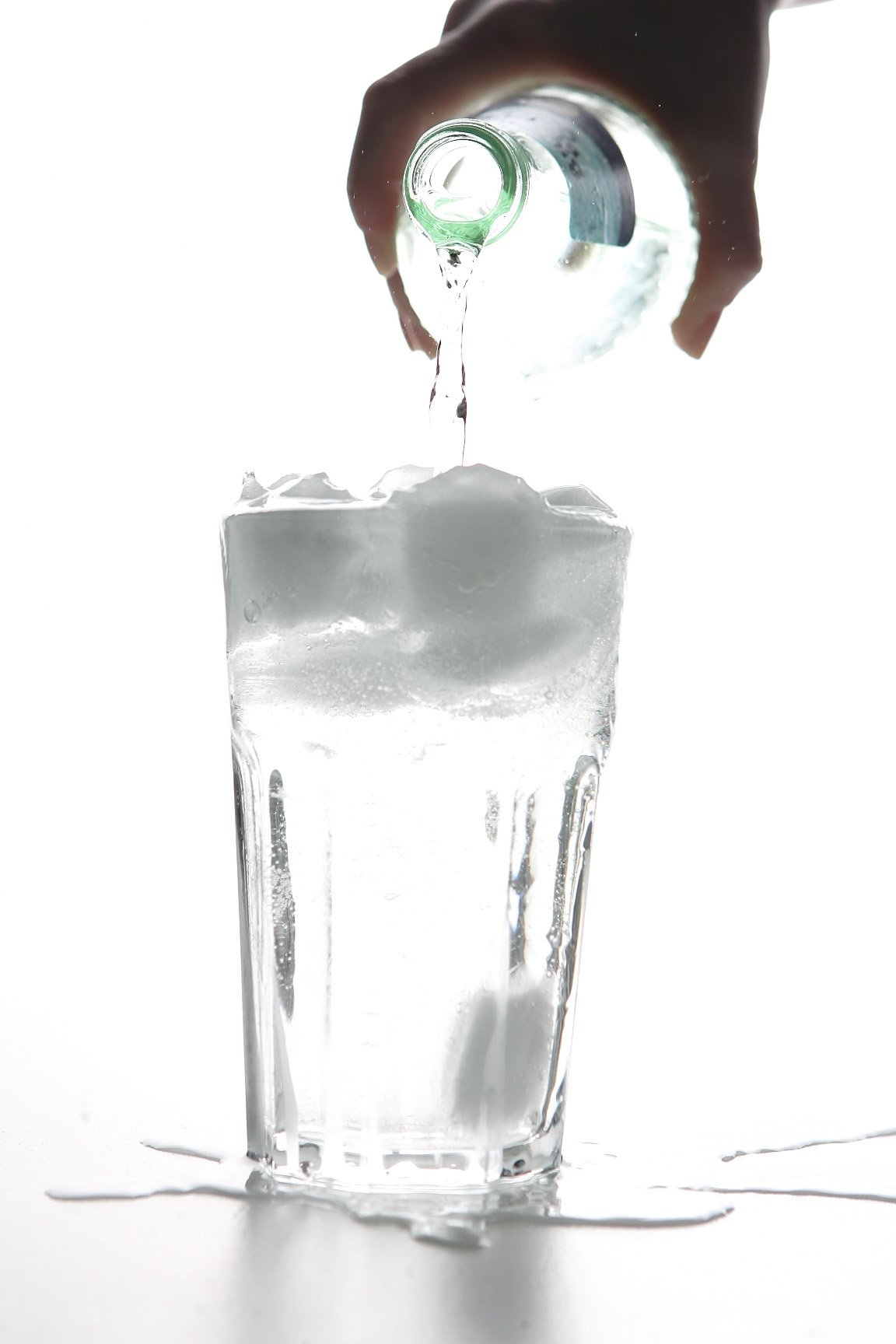 BERLIN - JANUARY 14: Water pours into a glass with ice cubes on January 14, 2007 in Berlin, Germany.  (Photo Illustration by Andreas Rentz/Getty Images)