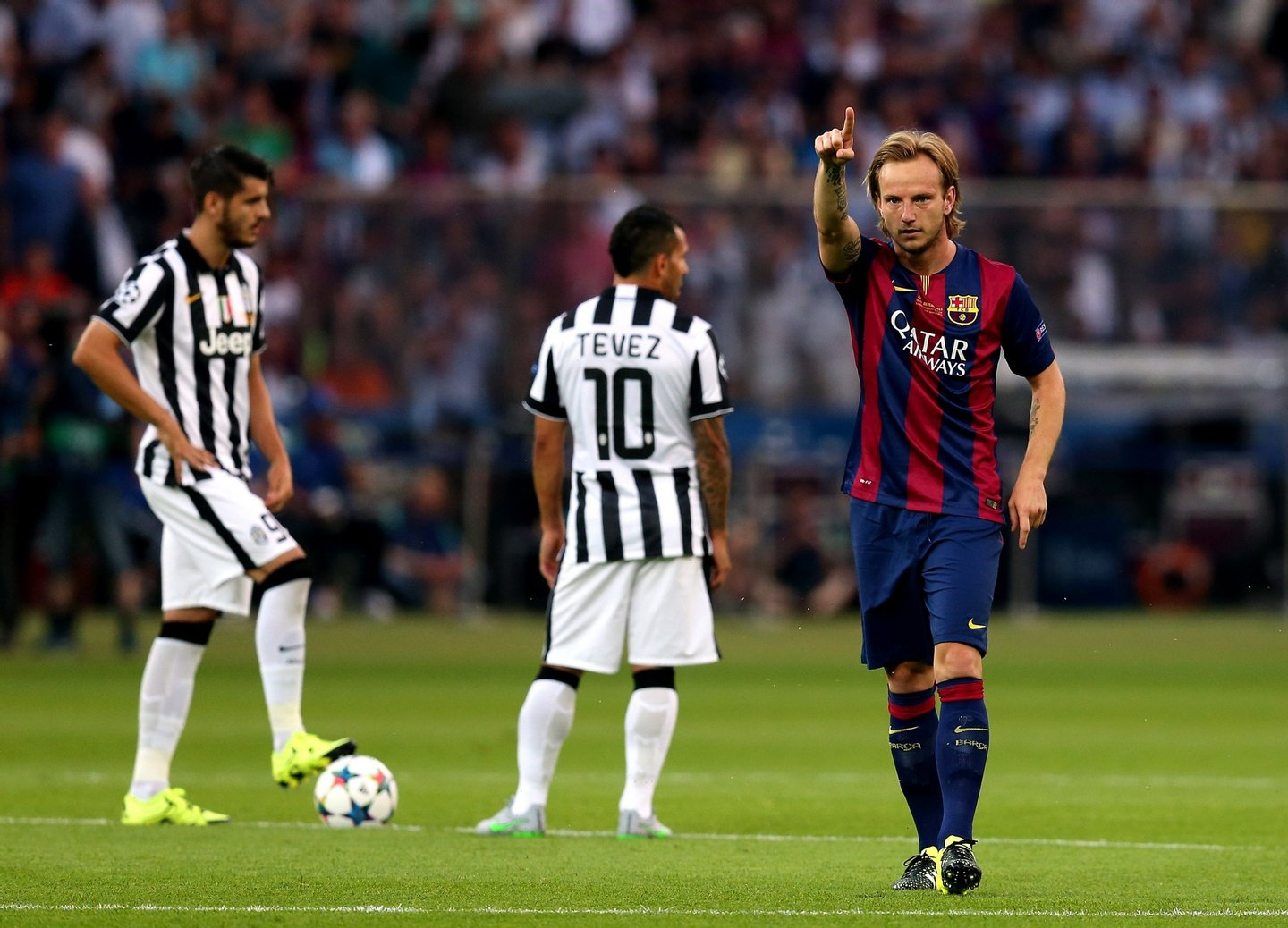 BERLIN, GERMANY - JUNE 6: Ivan Rakitic of FC Barcelona celebrates scoring the opening goal during the UEFA Champions League Final match between Juventus and FC Barcelona at the Olympiastadion on June 6, 2015 in Berlin, Germany. (Photo by Chris Brunskill Ltd/Getty Images)