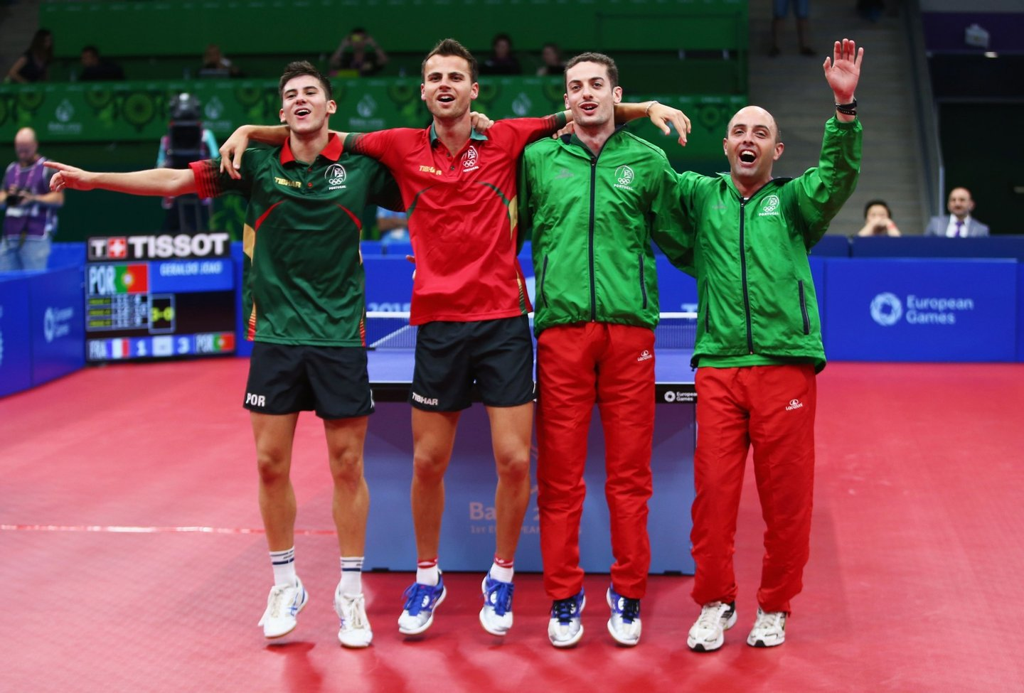 BAKU, AZERBAIJAN - JUNE 15:  Joao Geraldo, Tiago Apolonia, Marcos Freitas and coach of Portugal celebrate winning the gold medal in the Mens Table Tennis Team Final during day three of the Baku 2015 European Games at Baku Sports Hall on June 15, 2015 in Baku, Azerbaijan.  (Photo by Francois Nel/Getty Images for BEGOC)