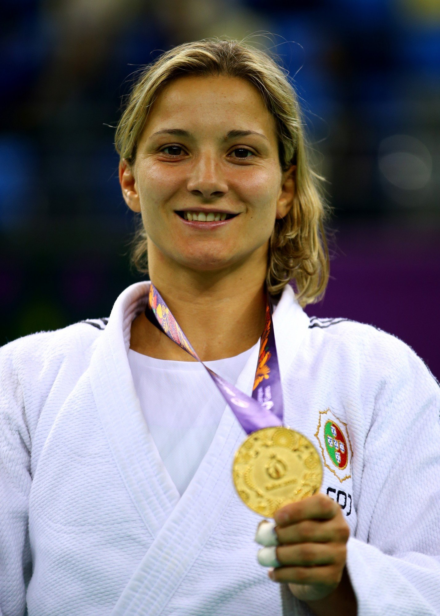 BAKU, AZERBAIJAN - JUNE 25:  Gold medalist Telma Monteiro of Portugal poses on the medal podium following the Women's Judo -57kg Finals during day thirteen of the Baku 2015 European Games at the Heydar Aliyev Arena on June 25, 2015 in Baku, Azerbaijan.  (Photo by Richard Heathcote/Getty Images for BEGOC)